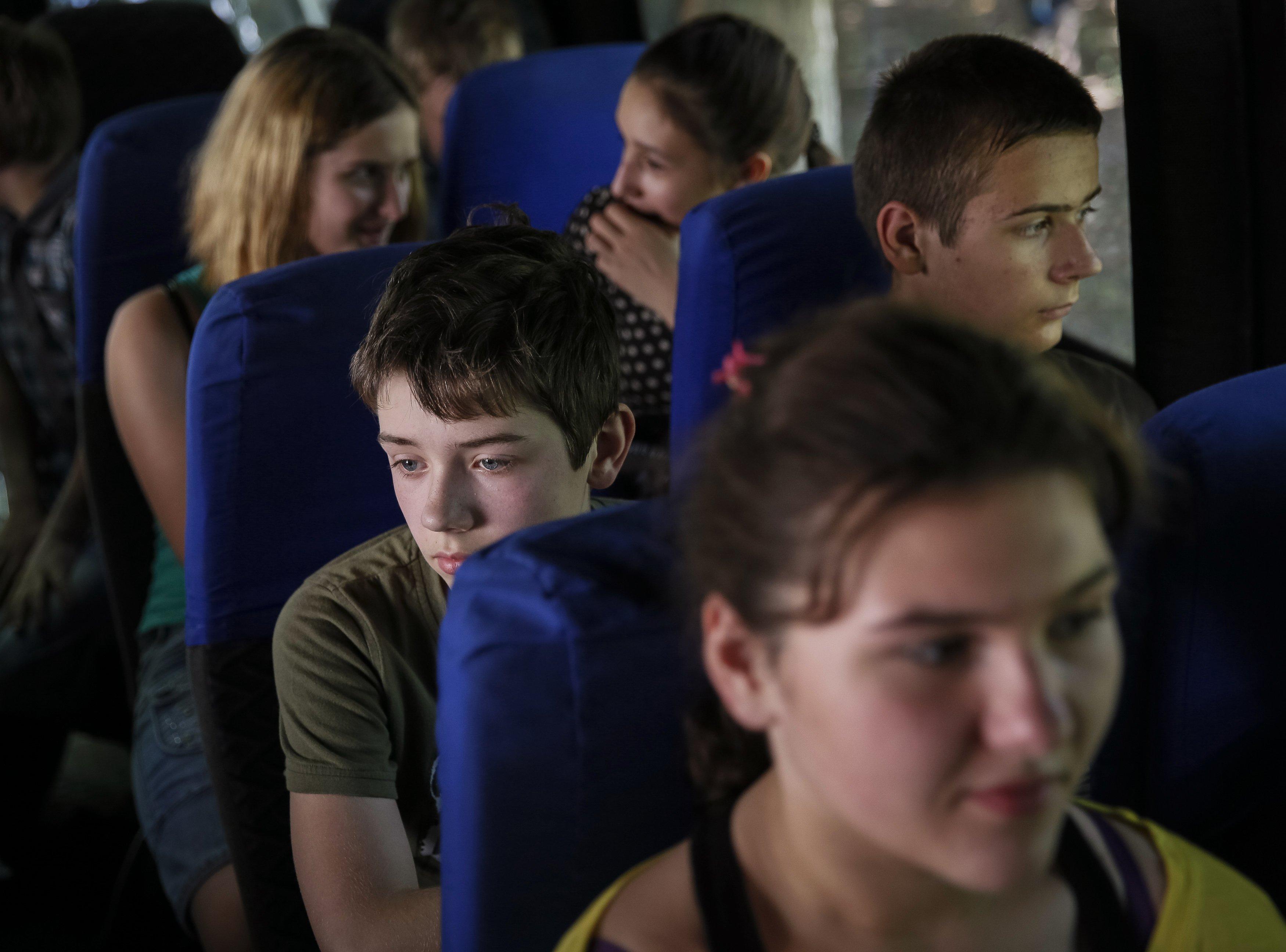 Children sit in a bus as they flee from fighting in Slaviansk, Ukraine on June 7, 2014.