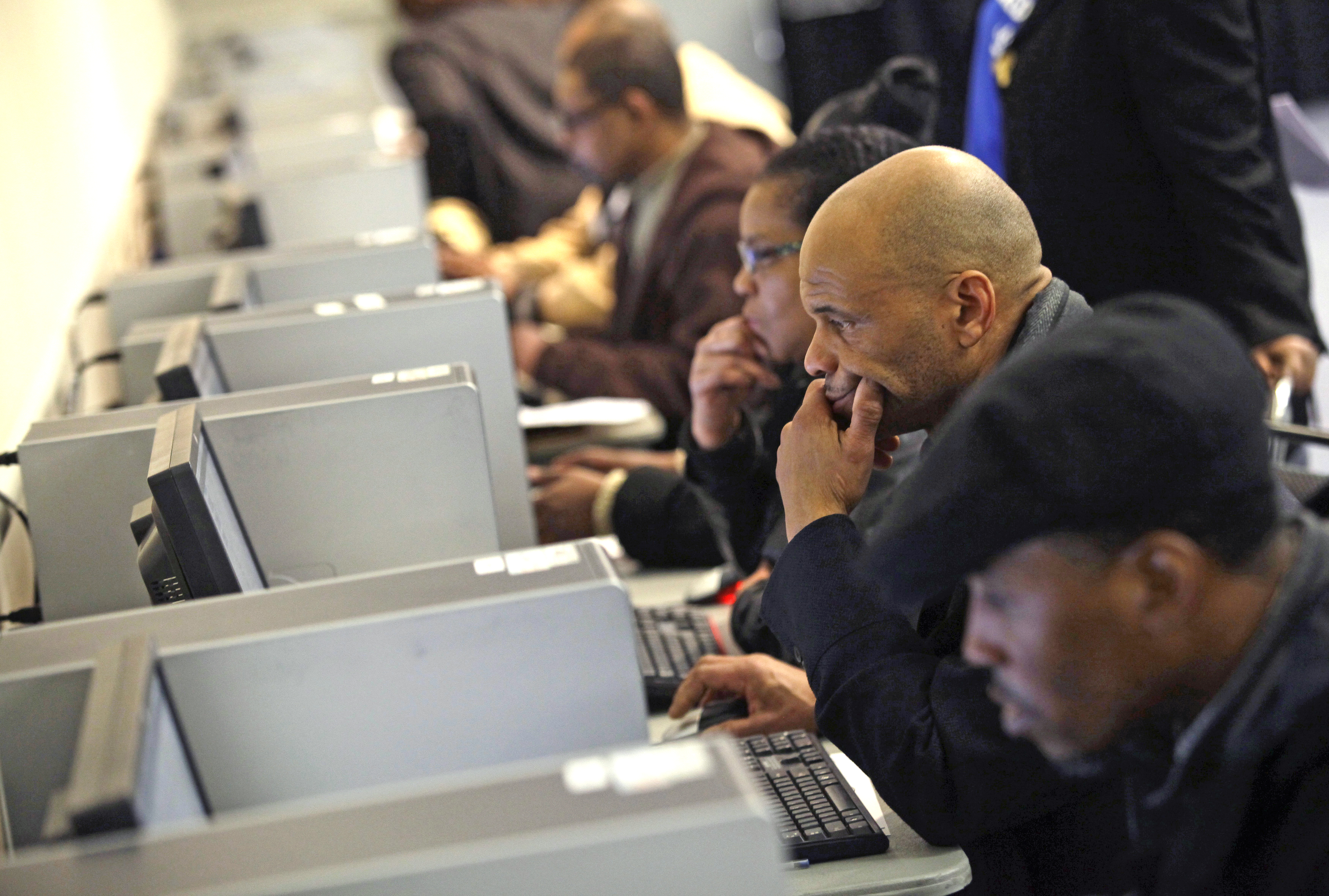 People use computers at a job fair in Detroit on March 1, 2014.