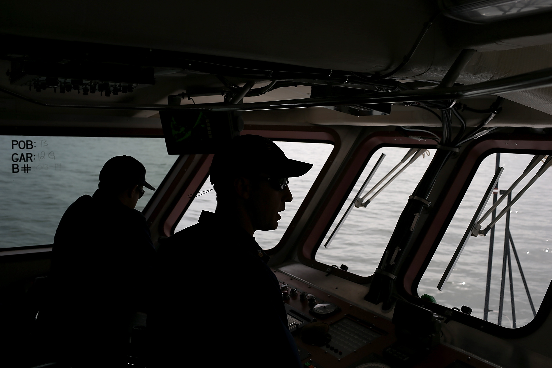 U.S. Coast Guards patrol in the San Francisco Bay on March 7, 2013.