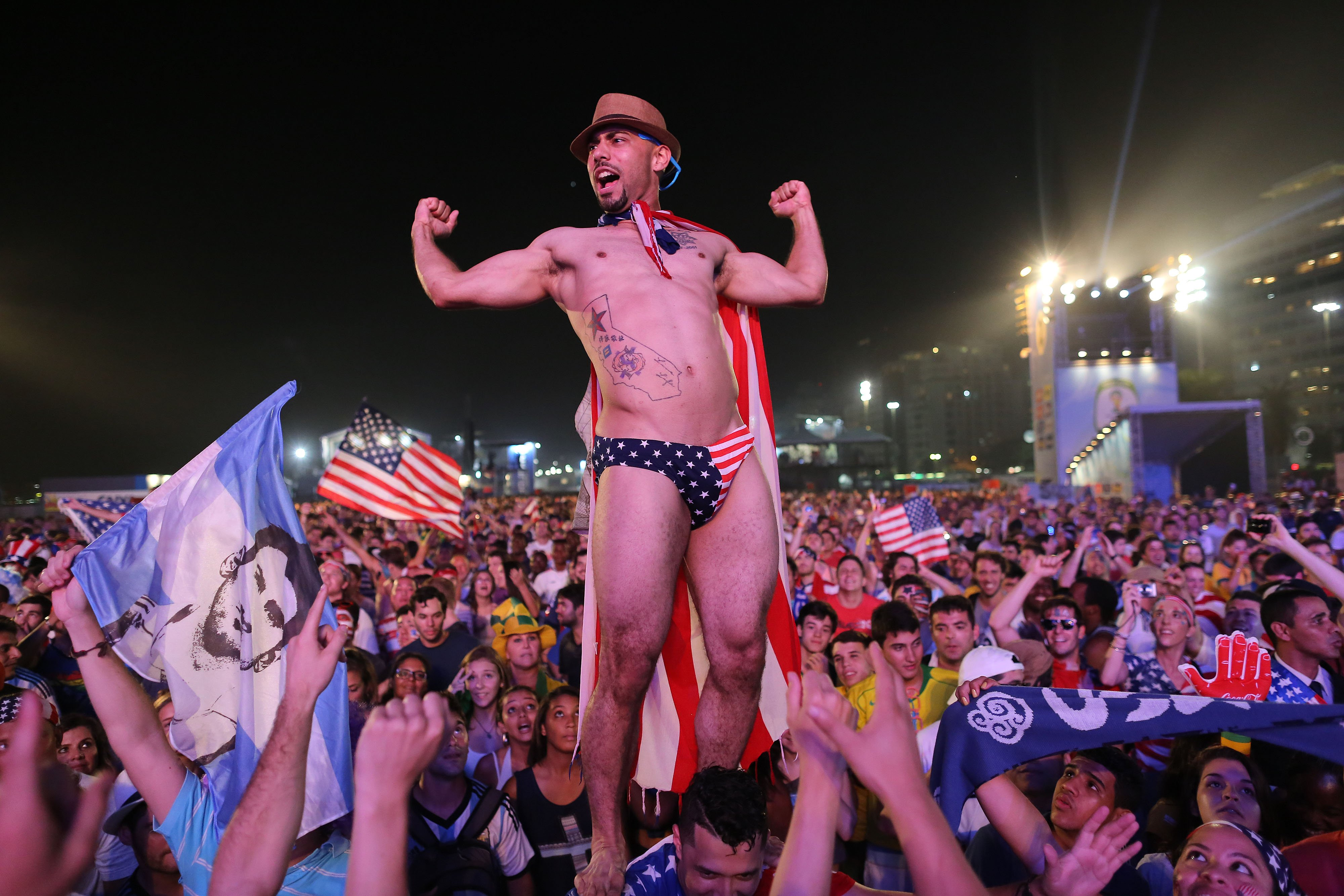 Soccer fans of the U.S. national soccer team cheer minutes before a live broadcast of the soccer World Cup match between USA and Ghana, inside the FIFA Fan Fest area in Rio de Janeiro on June 16, 2014.