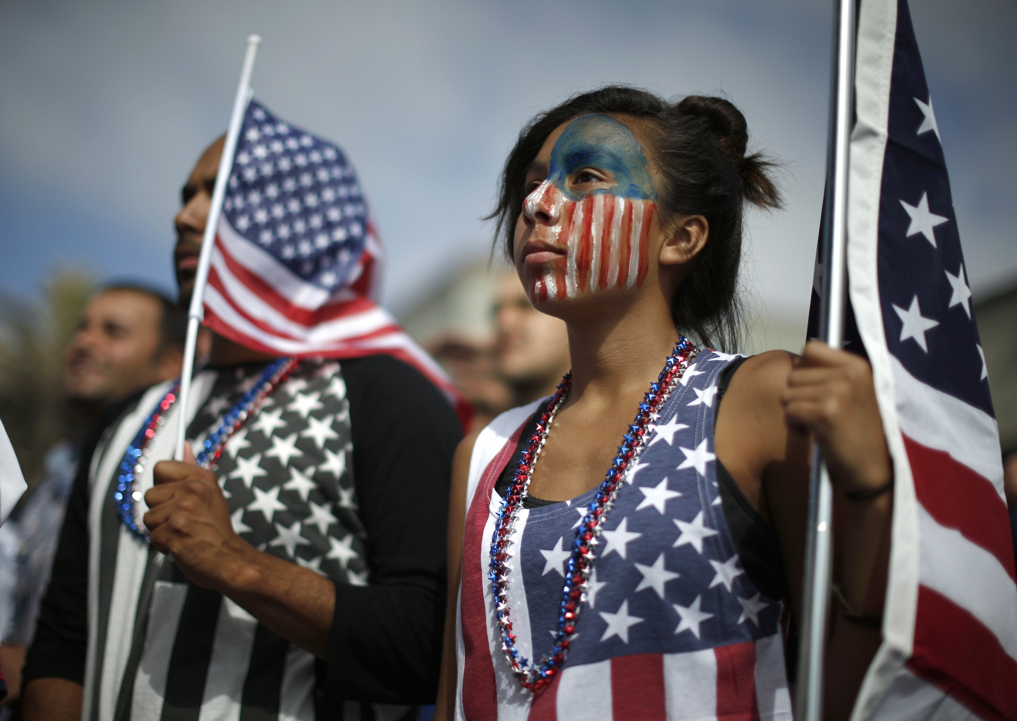 Michelle Lopez, 14, (R) watches the 2014 Brazil World Cup soccer match between Ghana and the U.S. at a viewing party in Hermosa Beach, Cailf. on June 16, 2014.