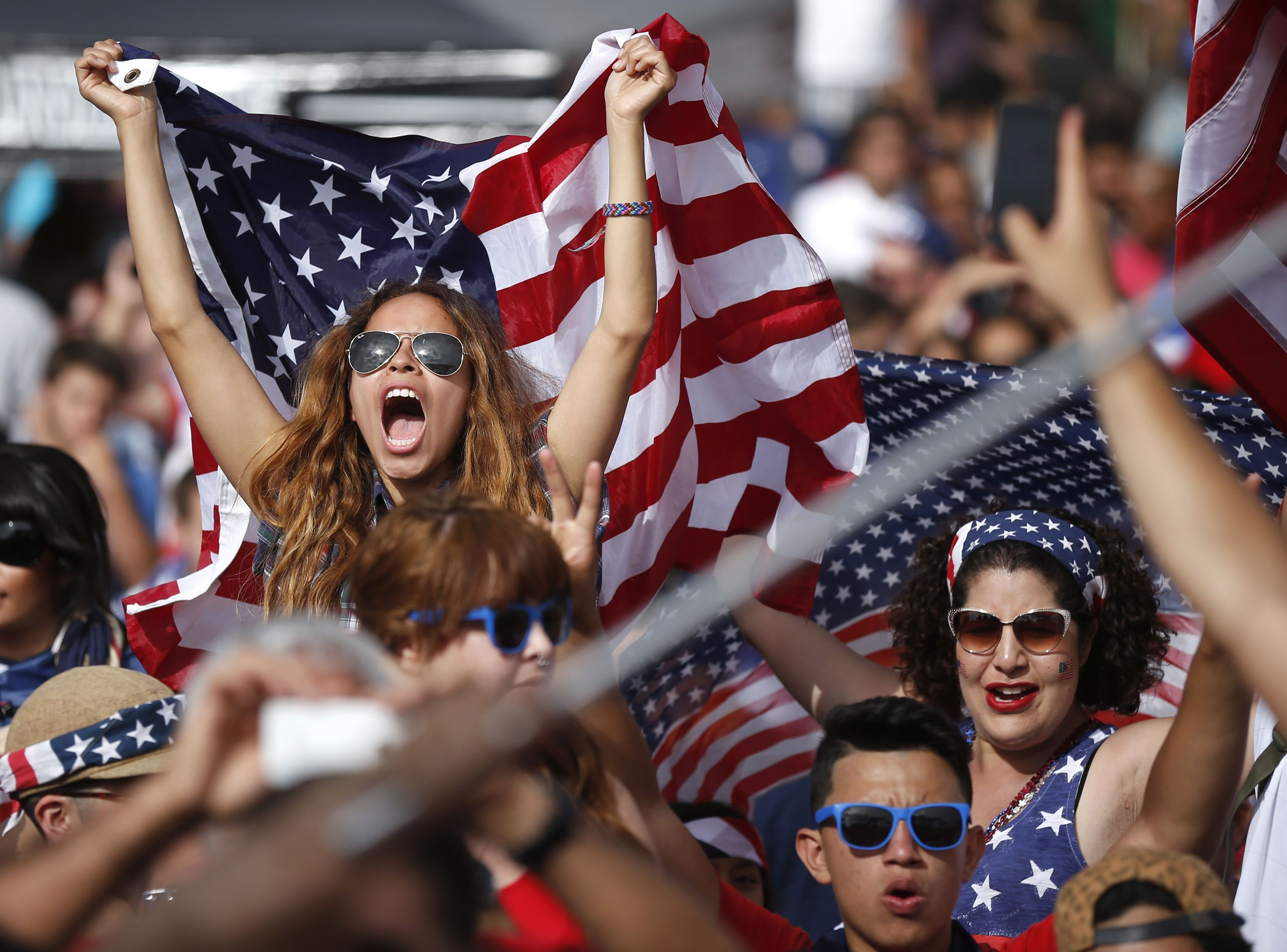 Fans cheer during the 2014 World Cup Group G soccer match between Ghana and the U.S. at a viewing party in Hermosa Beach, California on June 16, 2014.