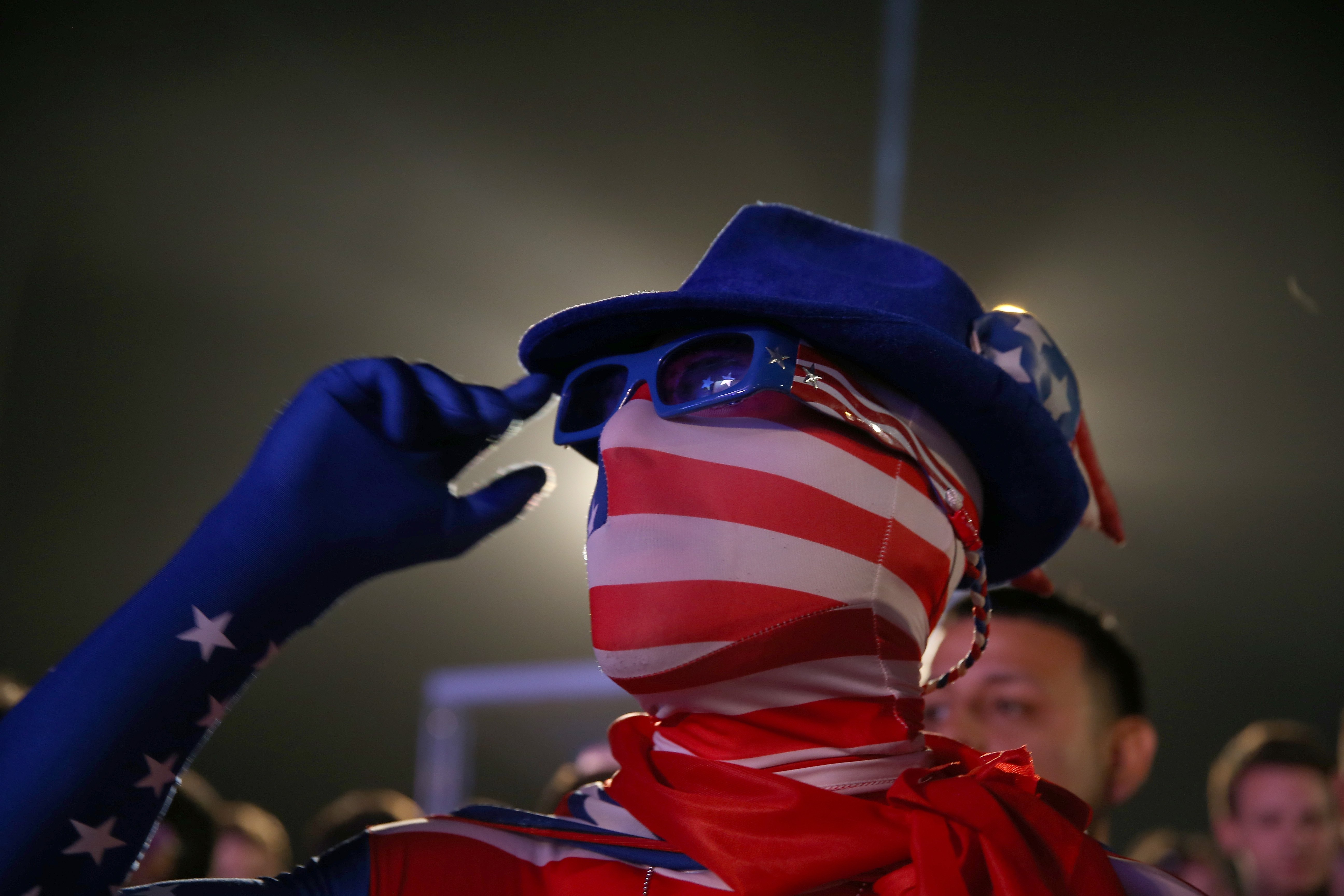 An American soccer fan waits for his team to play against Ghana at the FIFA World Cup Fan Fest on Copacabana beach on June 16, 2014 in Rio de Janeiro.
