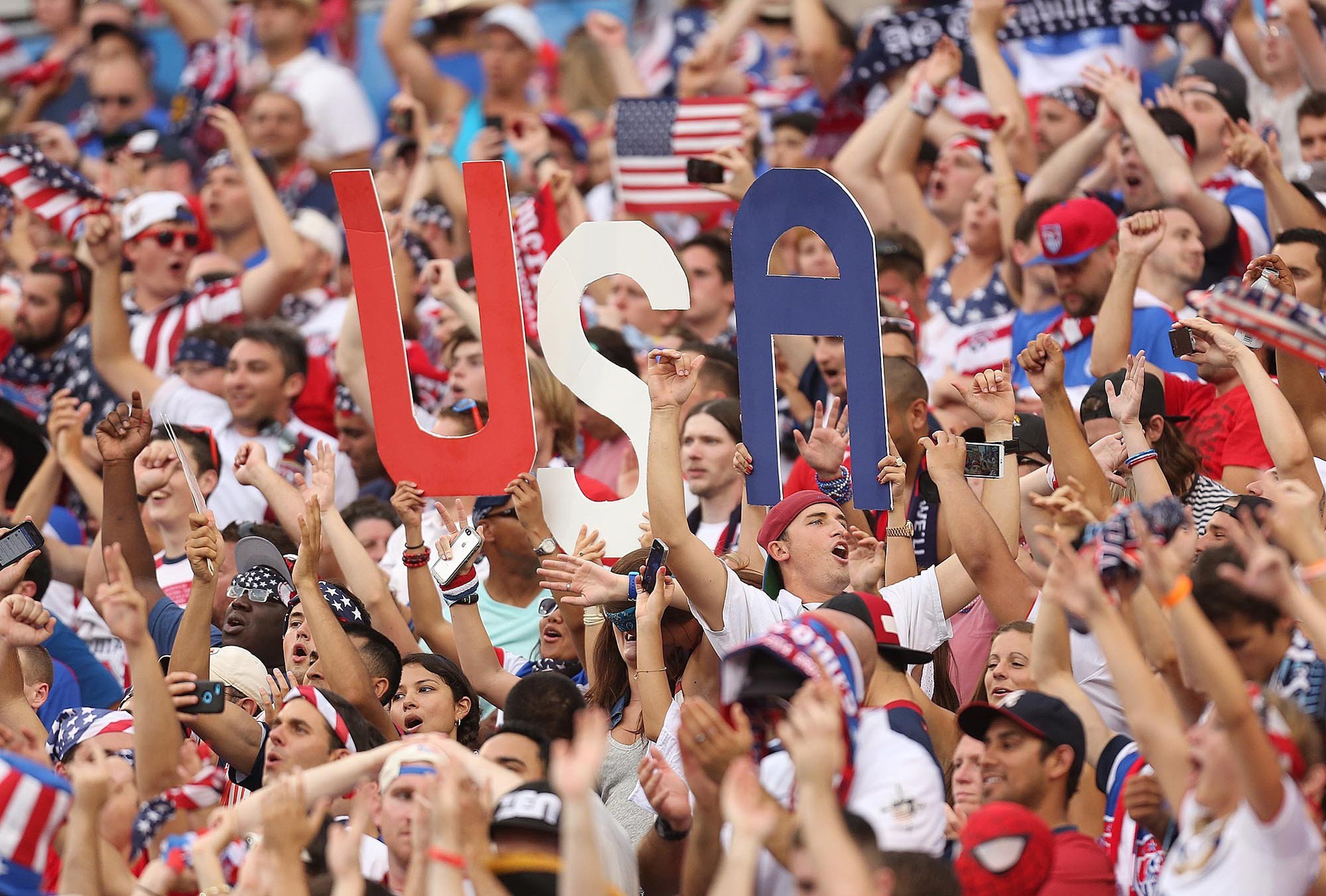 Fans celebrate during the United States' 2-1 win against Nigeria in a friendly in preparation for the World Cup, at EverBank Field in Jacksonville, Fla., on Saturday, June 7, 2014.