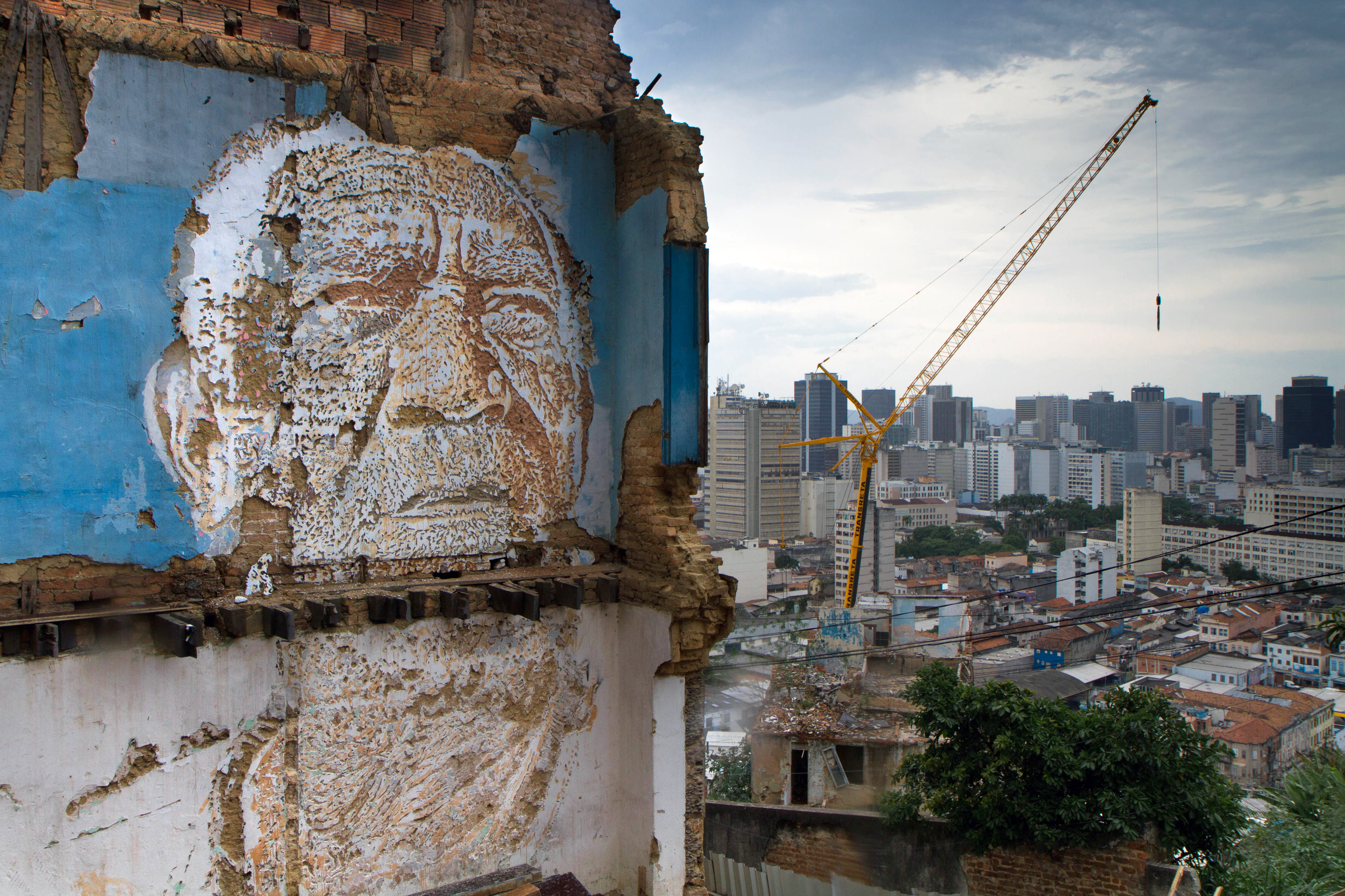 The artwork of Portuguese artist Alexandre Farto aka Vhils decorates the walls with faces that represent the people who live in Providencia, the oldest slum in Rio de Janeiro, Nov. 29, 2012.