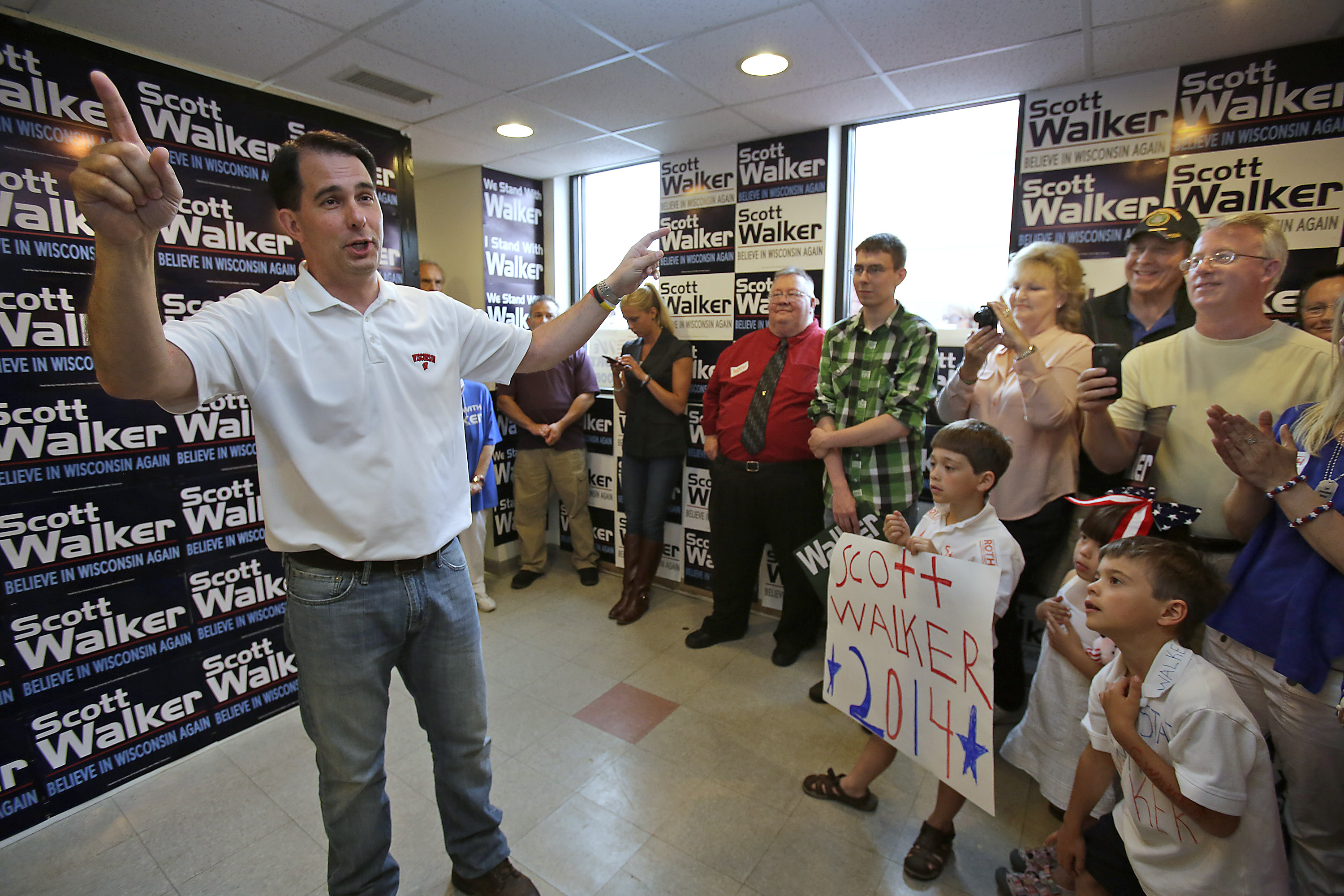 Wisconsin Governor Scott Walker makes a stop at the Republican Party of Wisconsin Appleton Headquarters Saturday, June 21, 2014 in Appleton, Wis.