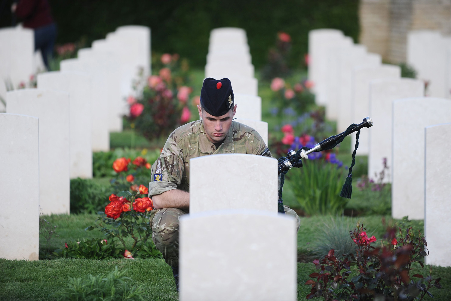 June 4, 2014. A British soldier pays his respects as he visits a military cemetery in Ranville, northwestern France.