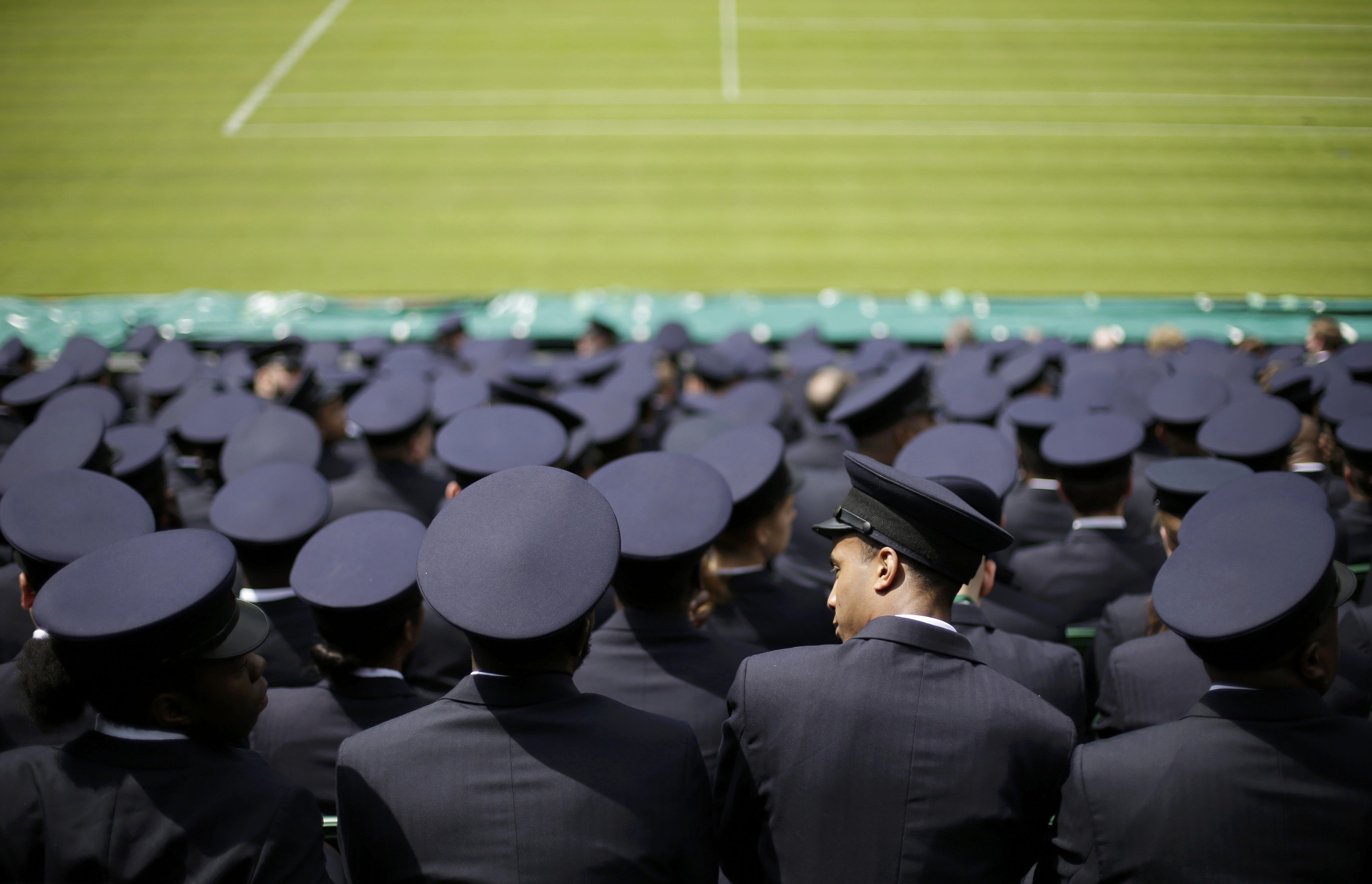 Stewards sit together for a meeting the day before the start of the Wimbledon Tennis Championships, in London on June 22, 2014.