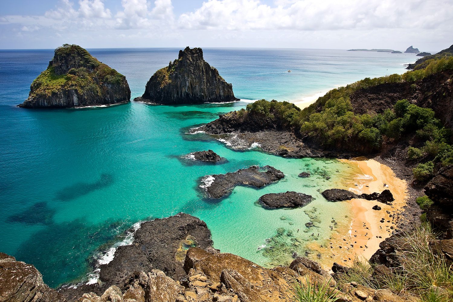 Fernando de Noronha, an archipelago of 21 islands about 200 miles off the Brazilian coast, is designated by UNESCO as a World Heritage Site and offers travelers stunning views of marine life.
