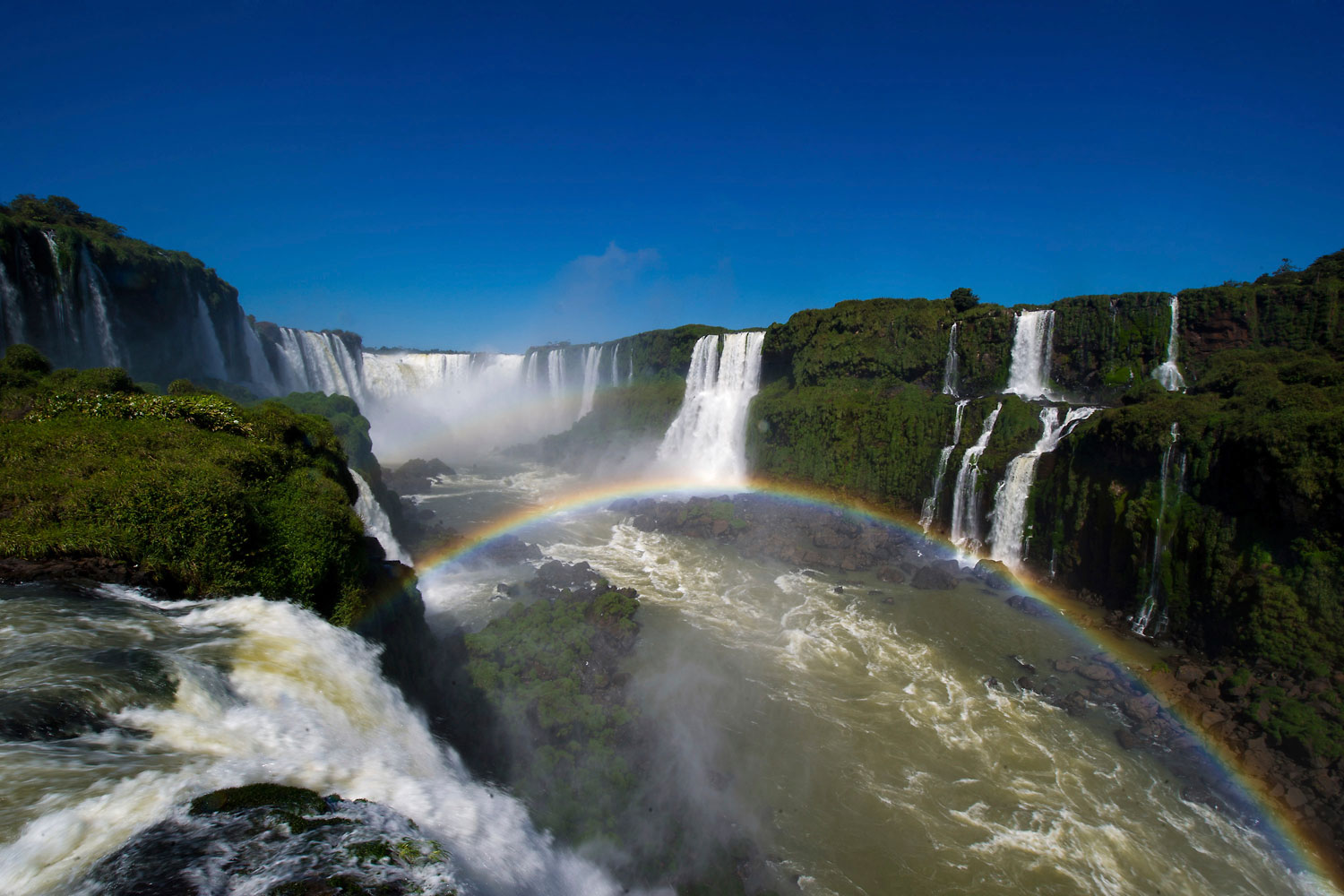 The Iguazu Falls, surrounded by lush forest and exotic wildlife, are a set of nearly 300 waterfalls in the Iguazu River located on the Brazil-Argentina border.