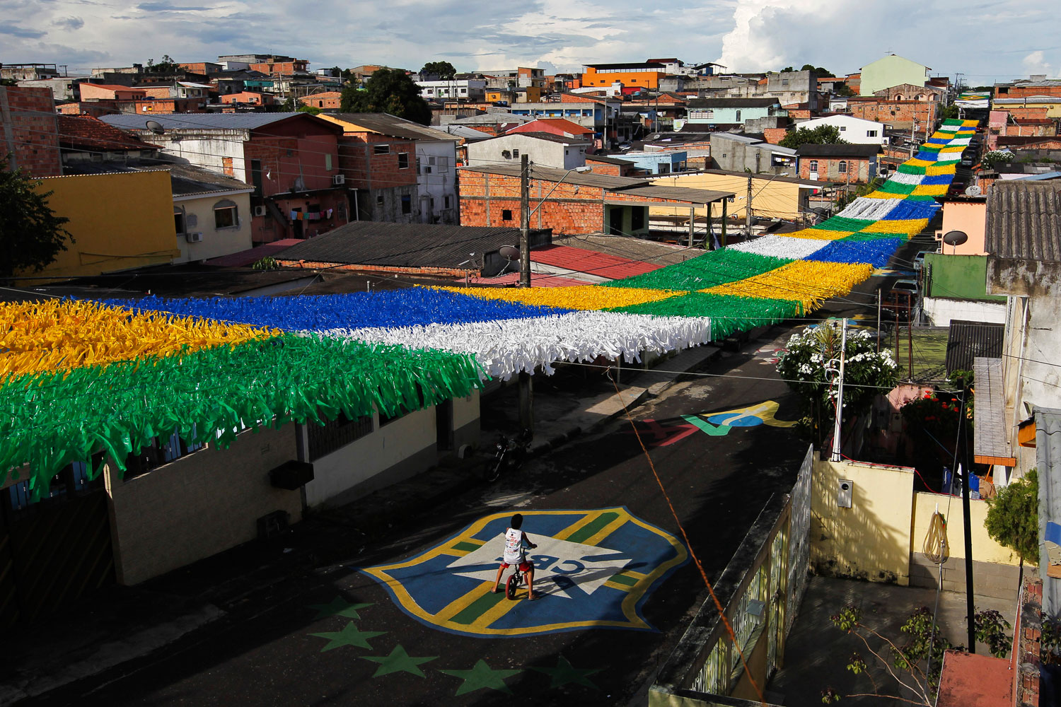 The Third Street of the Alvorada neighborhood, part of Brazil's southernmost state Rio Grande do Sul, is vibrantly decorated for the 2014 World Cup in Manaus, one of the tournament's 12 host cities.