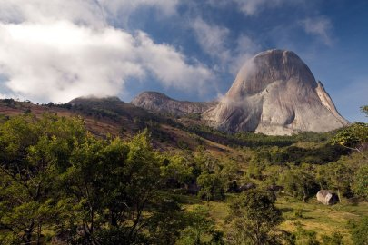 """The granite mountain Pedra Azul, Portugese for """"blue mountain,"""" is named for the shade of blue it appears to turn at dawn and sunset."""