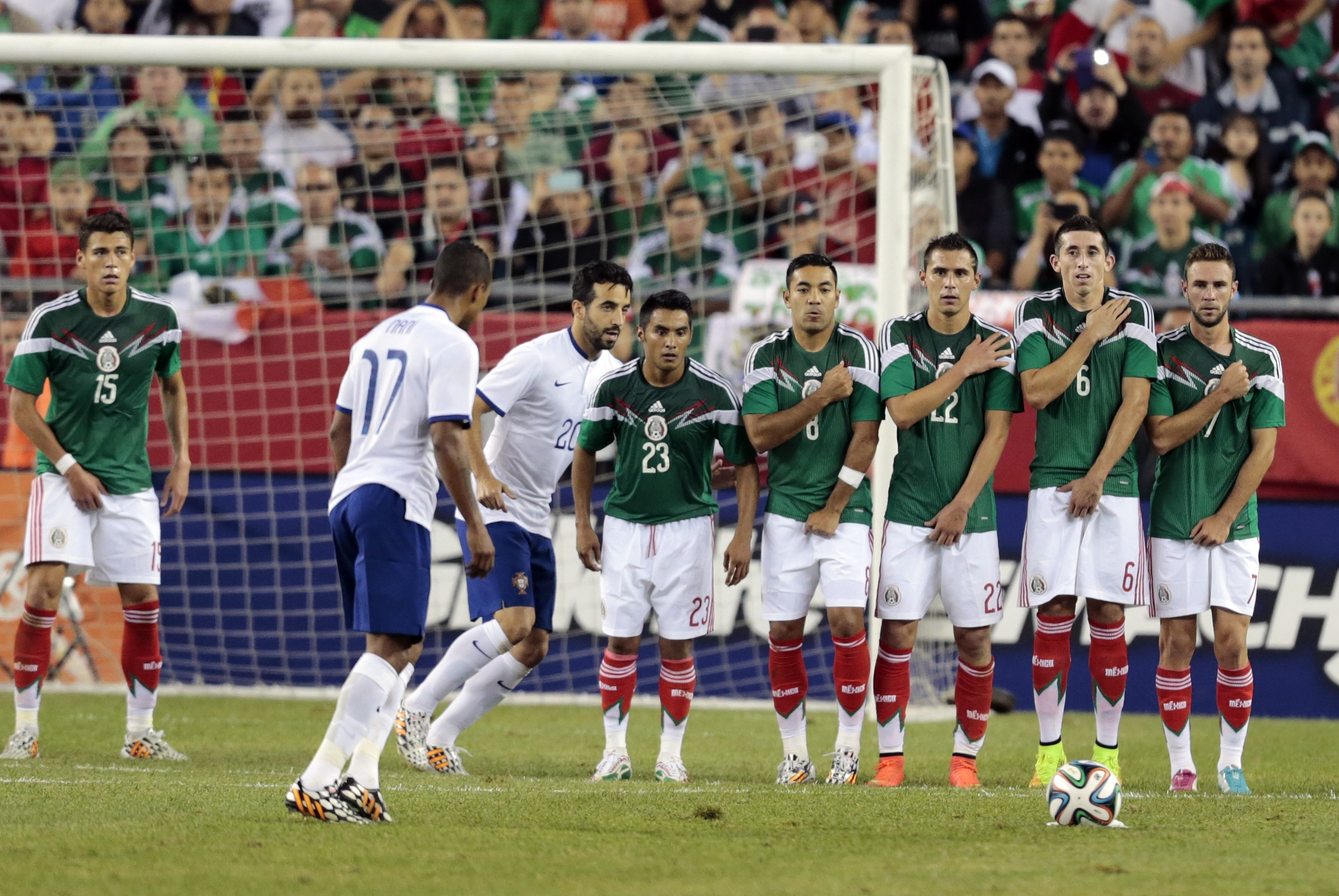 The Mexican wall waits for a free kick from Portugal's Nani (17) during an international friendly before the 2014 World Cup, Foxborough, Mass., June 6, 2014.