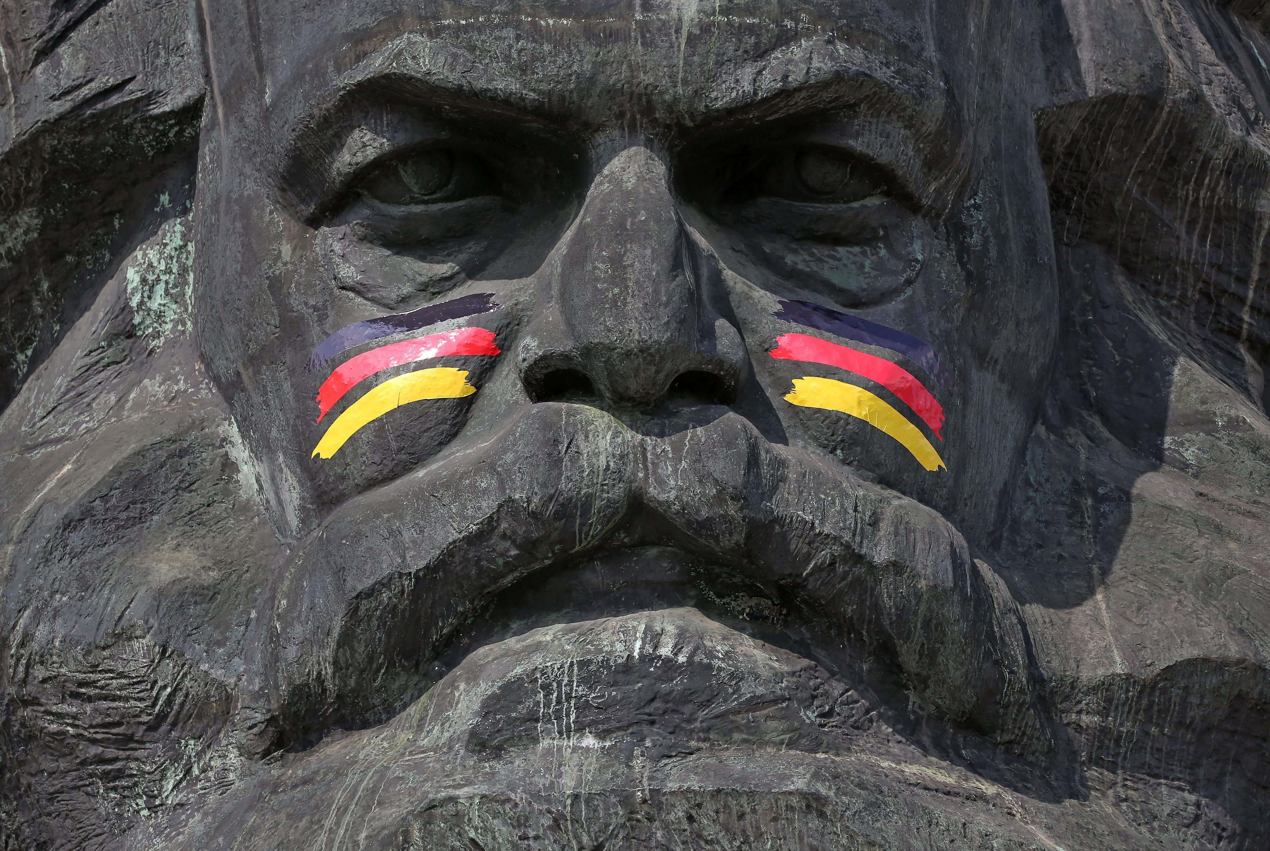 The Karl Marx monument has been decorated with German flags painted on his cheeks in Chemnitz, Germany on June 16, 2014.