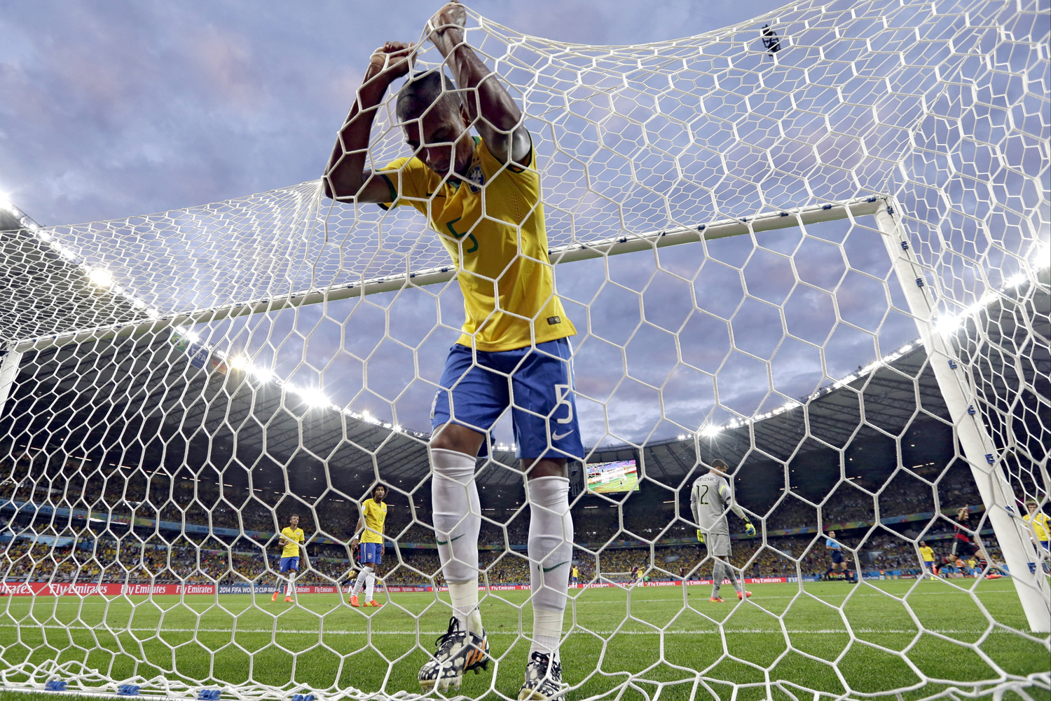 Brazil's Fernandinho reacts after Germany's Toni Kroos scored his side's third goal during the World Cup semifinal soccer match between Brazil and Germany, that ended in a 7-1 German victory, at the Mineirao Stadium in Belo Horizonte, Brazil, July 8, 2014.