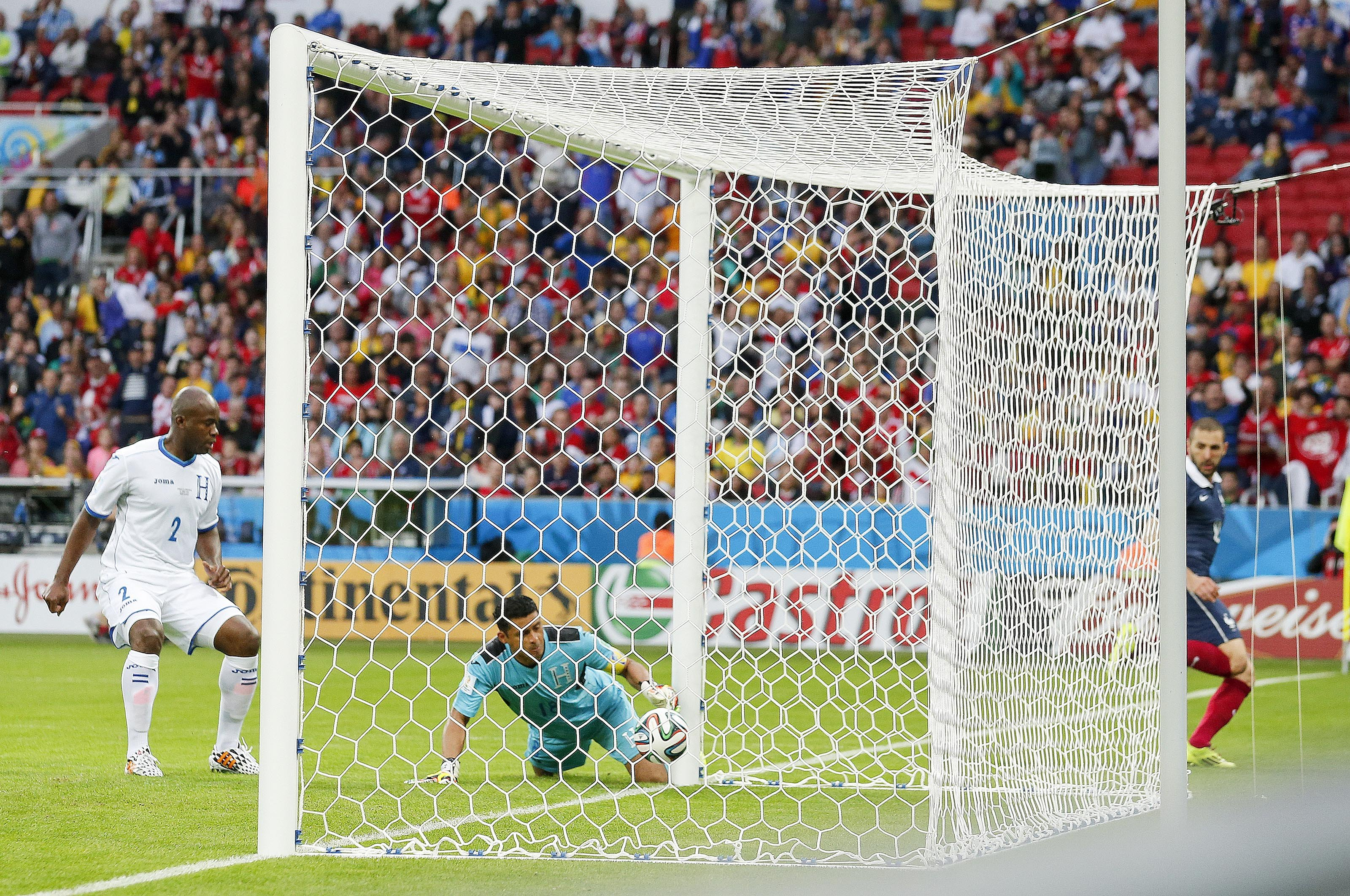 Honduras' goalkeeper Noel Valladares bundles a shot from France's Karim Benzema, far right, into his net for an own goal during the group E World Cup soccer match between France and Honduras at the Estadio Beira-Rio in Porto Alegre, Brazil on June 15, 2014.
