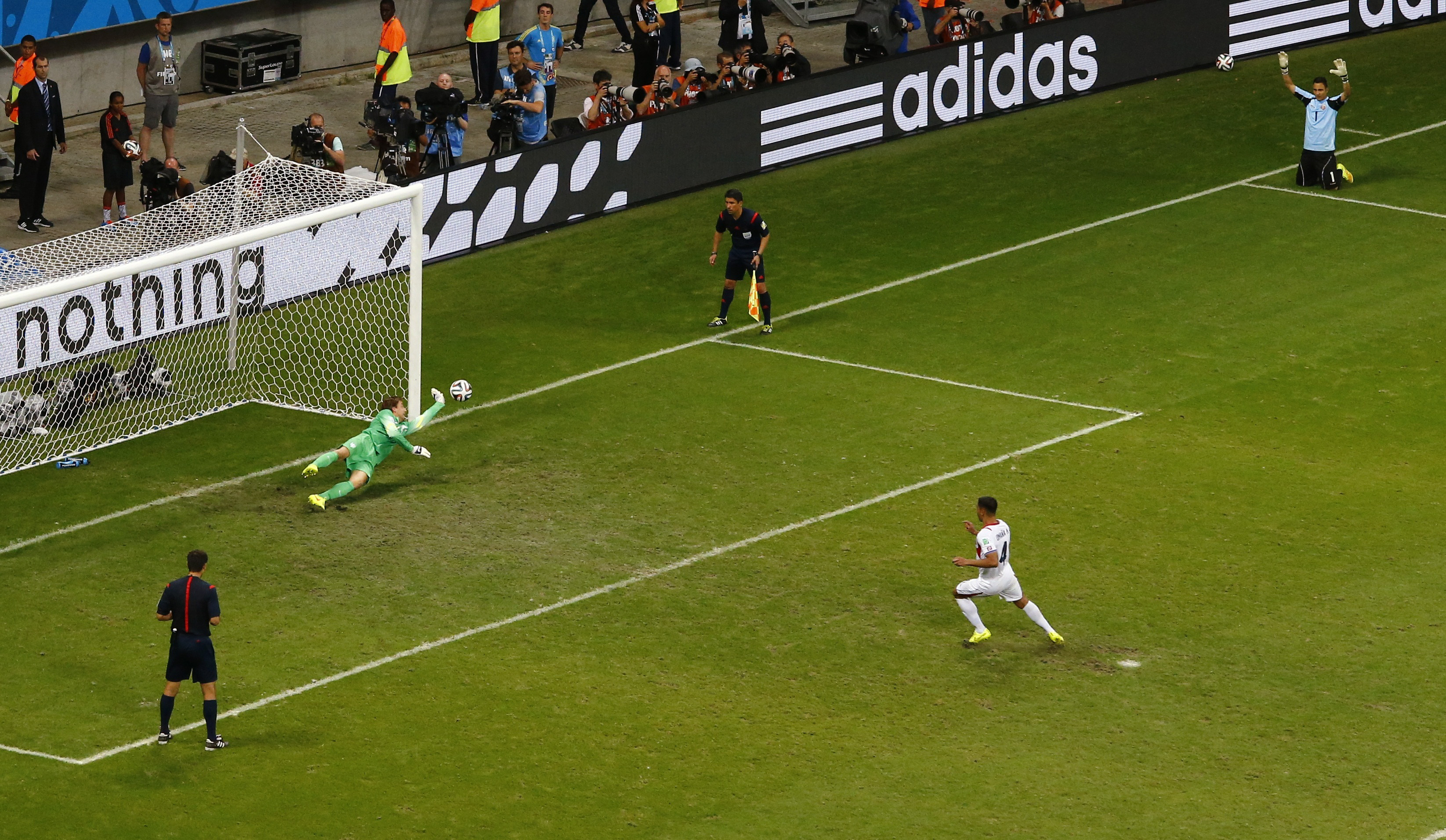 Substitute goalkeeper Tim Krul of the Netherlands makes a save on a shot at goal by Costa Rica's Michael Umana (R) during a penalty shootout in their 2014 World Cup quarter-finals at the Fonte Nova arena in Salvador, Brazil,  July 5, 2014.