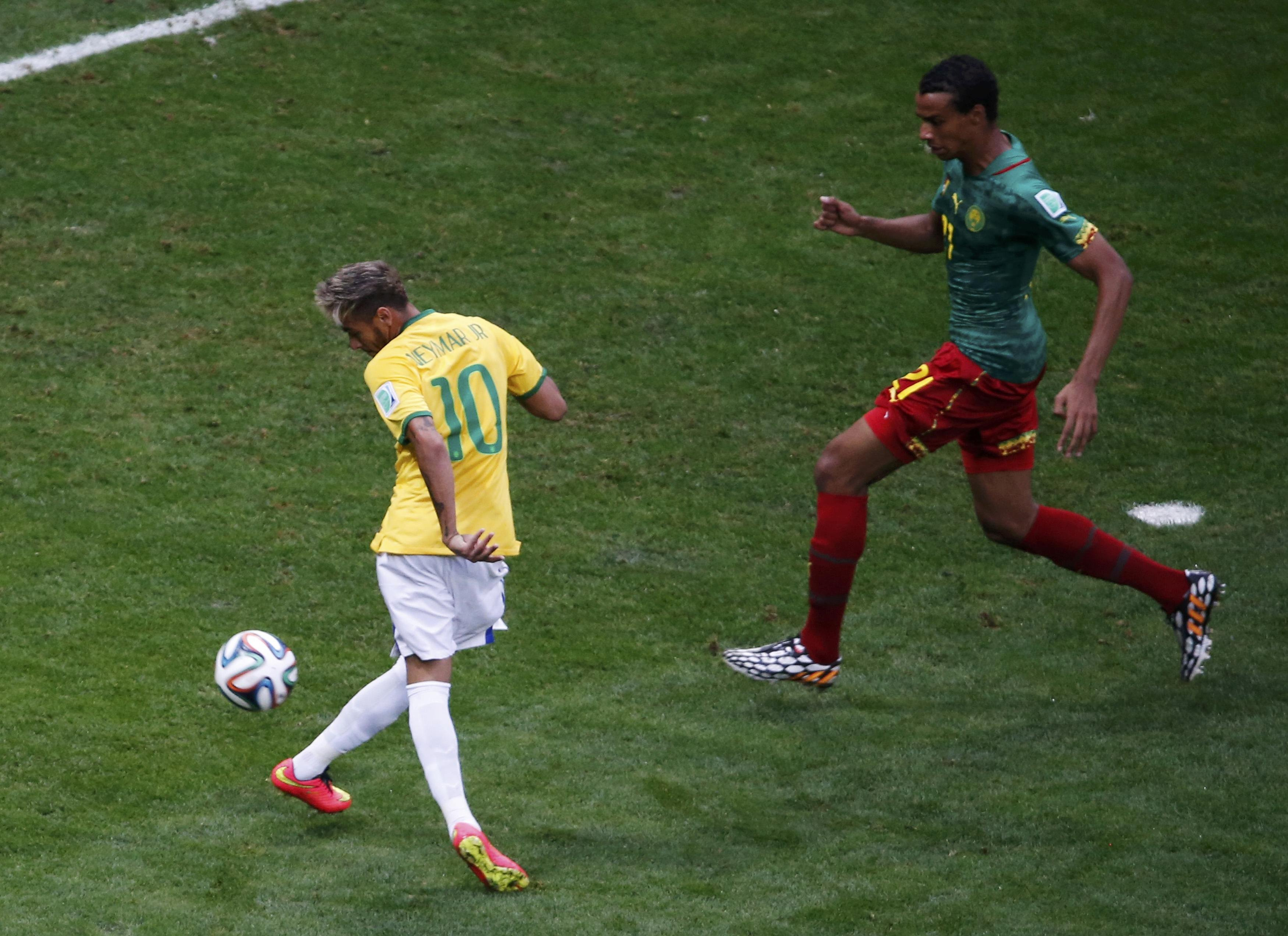 Brazil's Neymar shoots to score against Cameroon during their 2014 World Cup Group A soccer match at the Brasilia national stadium in Brasilia, Brazil on June 23, 2014.