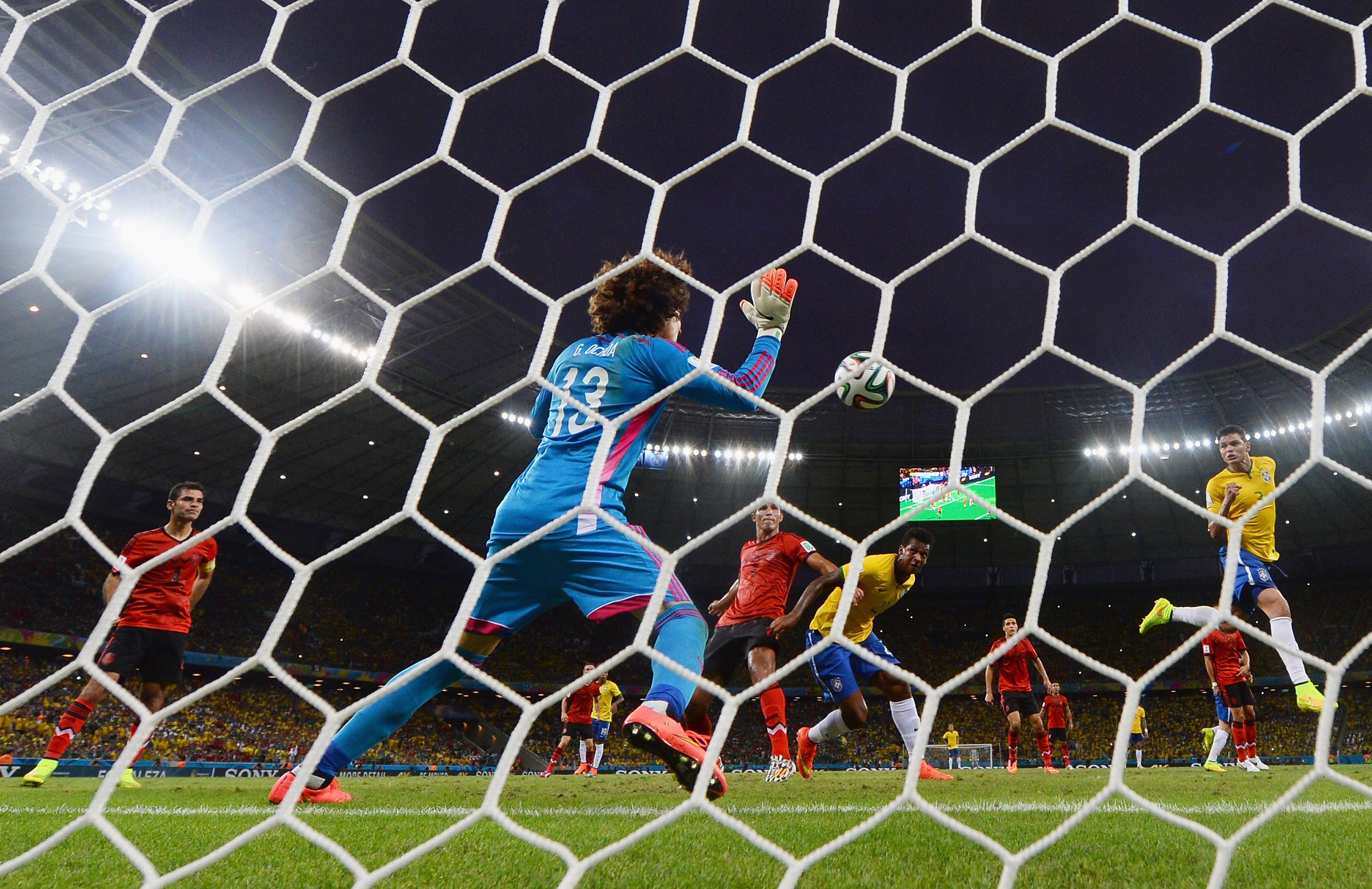 Guillermo Ochoa of Mexico makes a save after a header by Thiago Silva of Brazil during the 2014 FIFA World Cup Brazil Group A match between Brazil and Mexico at Castelao on June 17, 2014 in Fortaleza, Brazil.