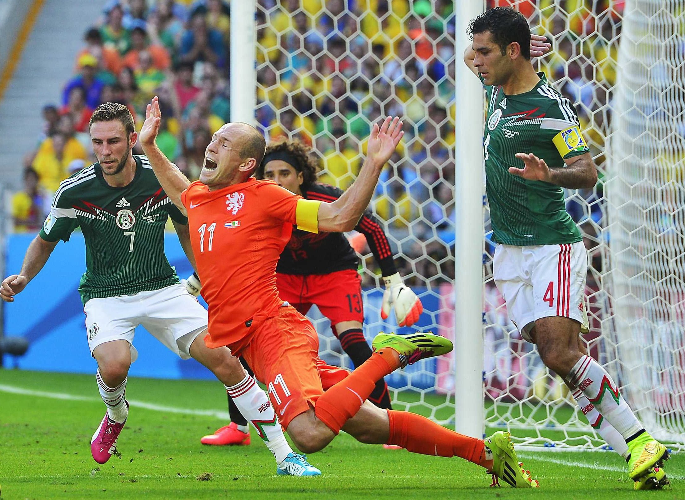 Rafael Marquez gets called for a foul against Arjen Robben of the Netherlands in the box during the match between the Netherlands and Mexico at the Estadio Castelao in Fortaleza, Brazil on June 29, 2014.