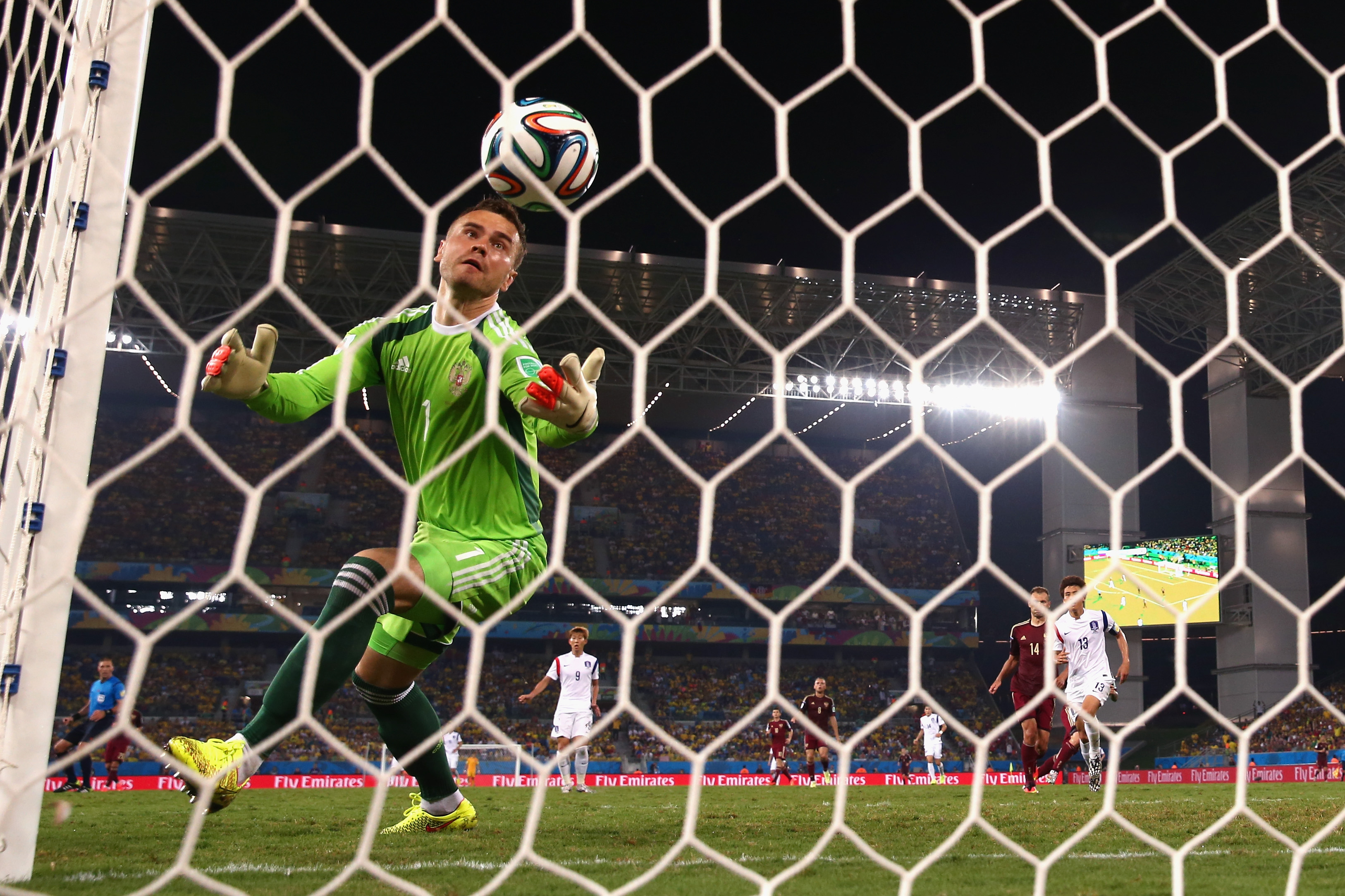 Igor Akinfeev of Russia fails to save a shot by Lee Keun-Ho of South Korea for South Korea's first goal during the 2014 FIFA World Cup Brazil Group H match between Russia and South Korea at Arena Pantanal on June 17, 2014 in Cuiaba, Brazil.