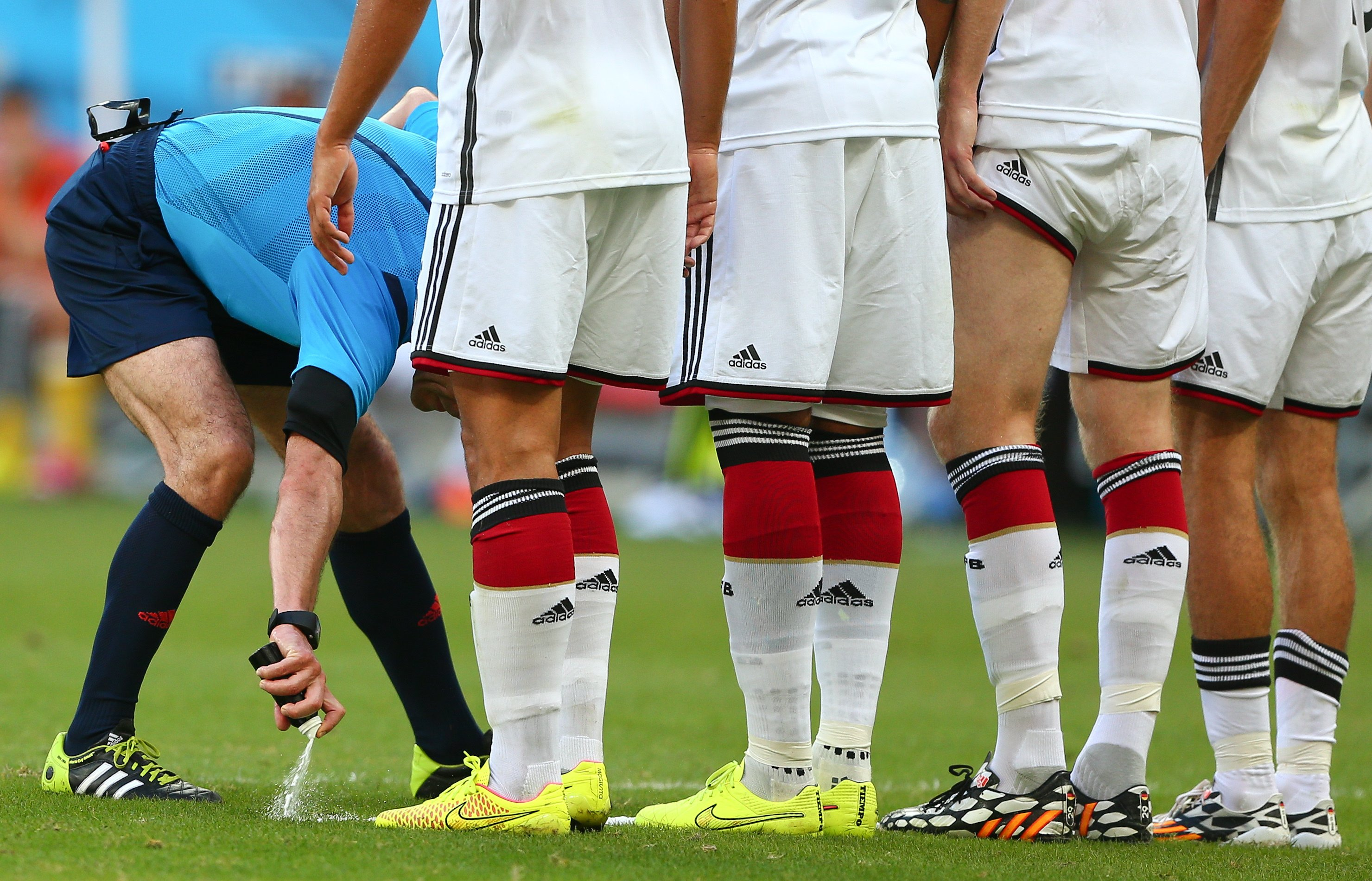 Referee Milorad Mazic uses vanishing spray to mark where the Germany wall must stand for a Portugal free kick during the 2014 FIFA World Cup Brazil Group G match between Germany and Portugal at Arena Fonte Nova.