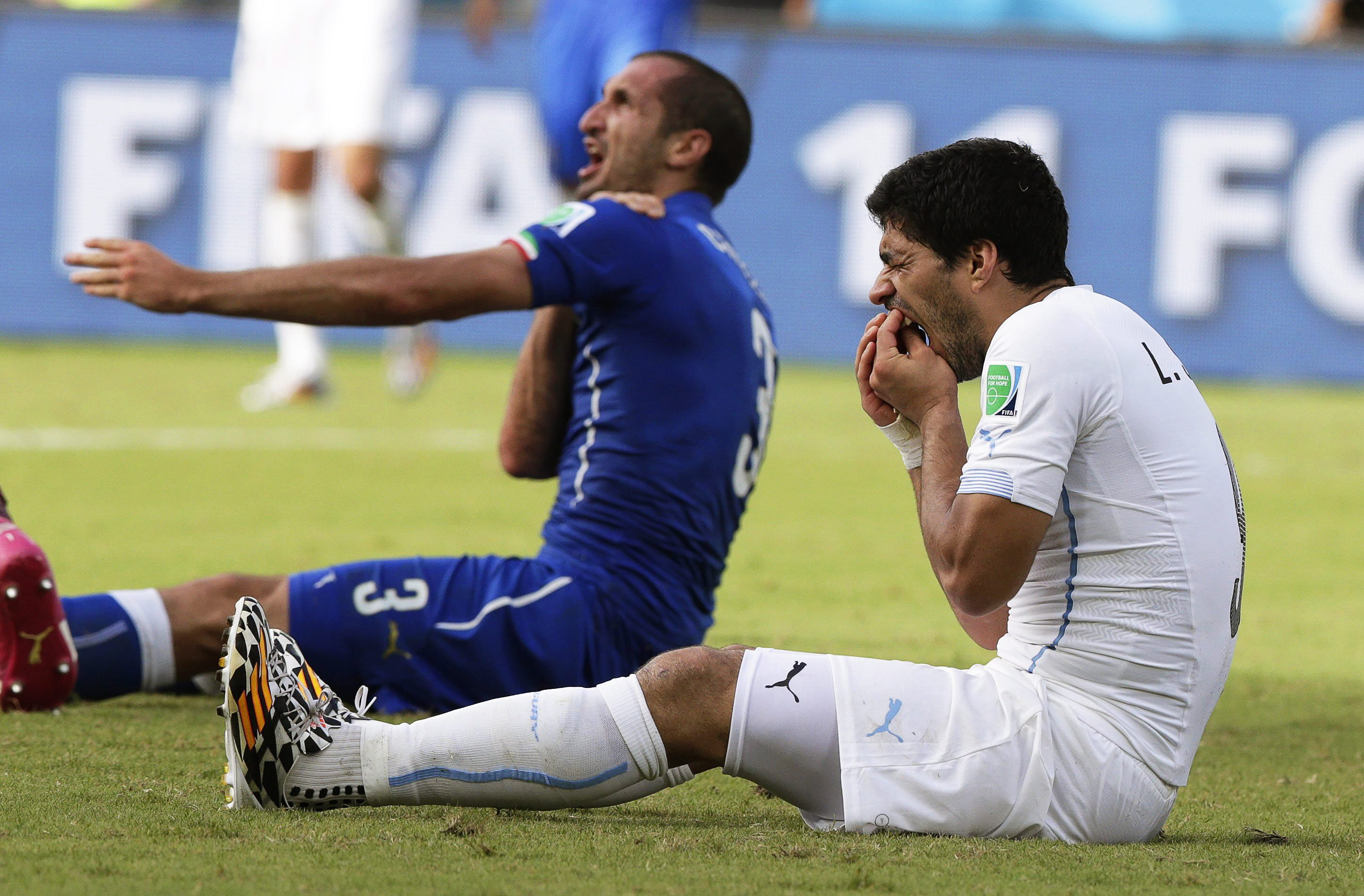 Giorgio Chiellini claims he was bitten by Uruguay's Luis Suarez during the FIFA World Cup 2014 group D preliminary round match between Italy and Uruguay at the Estadio Arena das Dunas in Natal, Brazil on June 24, 2014.