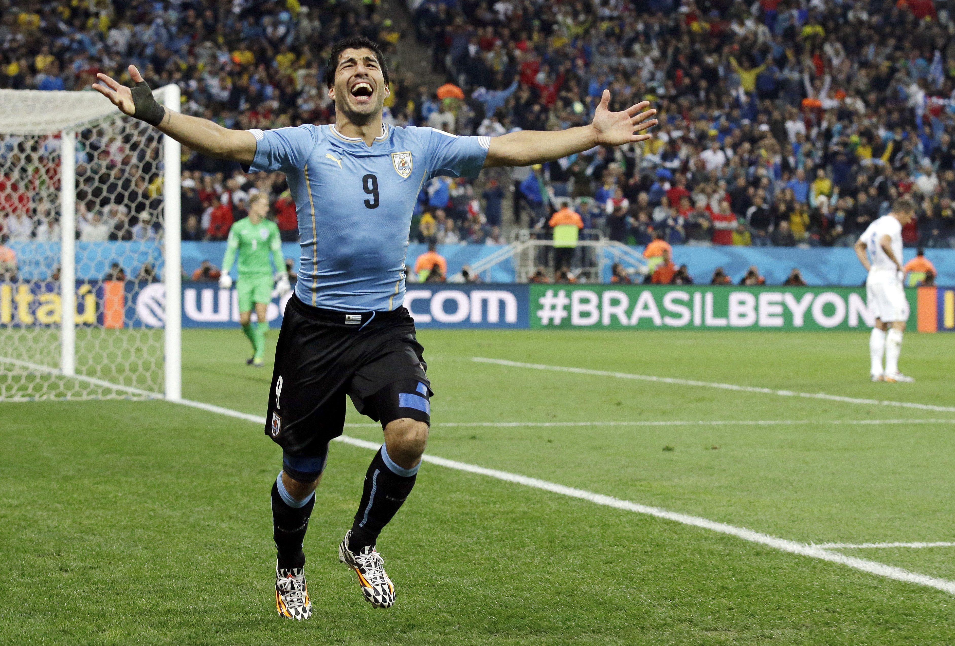 Uruguay's Luis Suarez celebrates after scoring his side's second goal during the group D World Cup soccer match between Uruguay and England at the Itaquerao Stadium in Sao Paulo, Brazil on June 19, 2014.