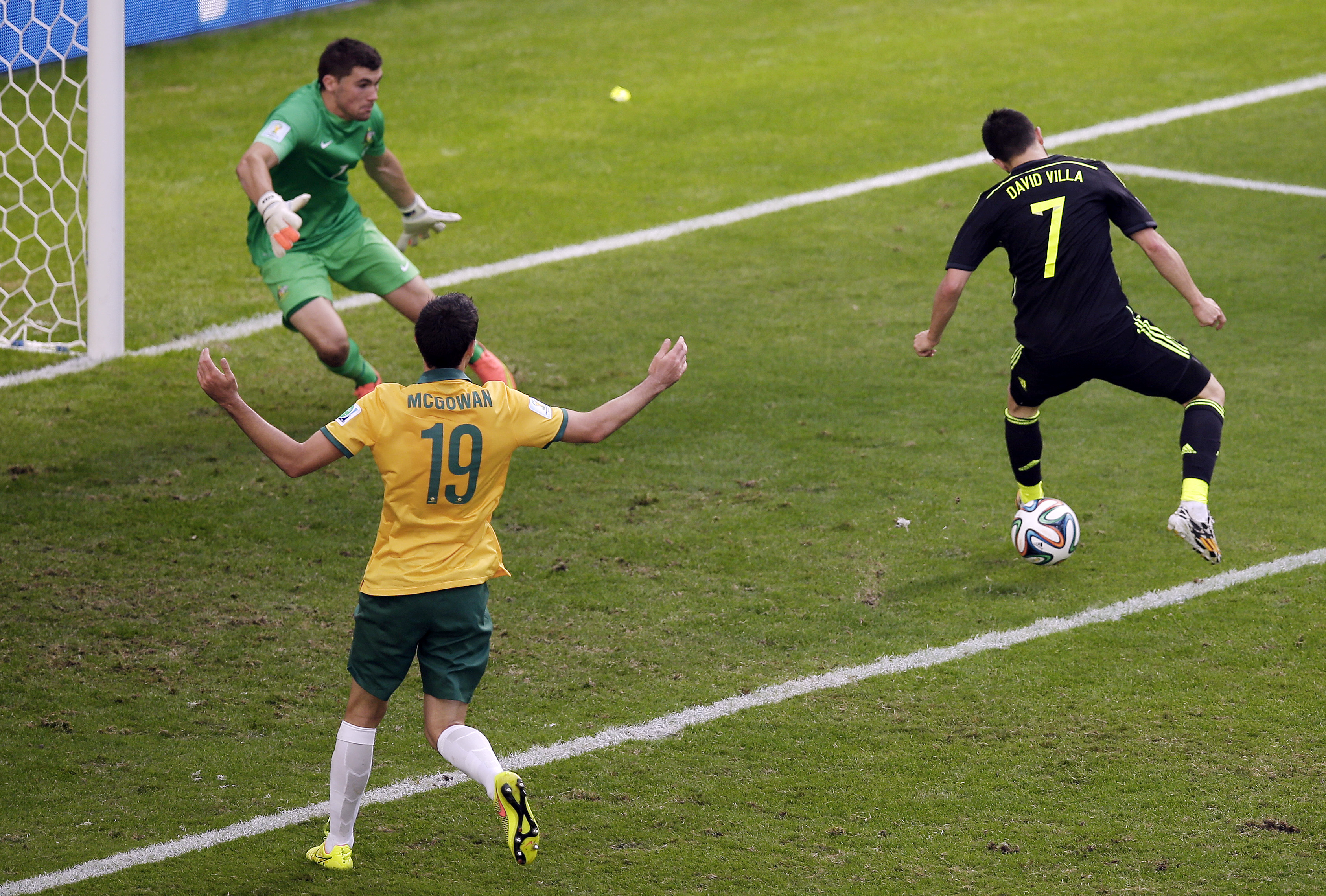 Spain's David Villa scores the team's first goal during the group B World Cup soccer match between Australia and Spain at the Arena da Baixada in Curitiba, Brazil on June 23, 2014.