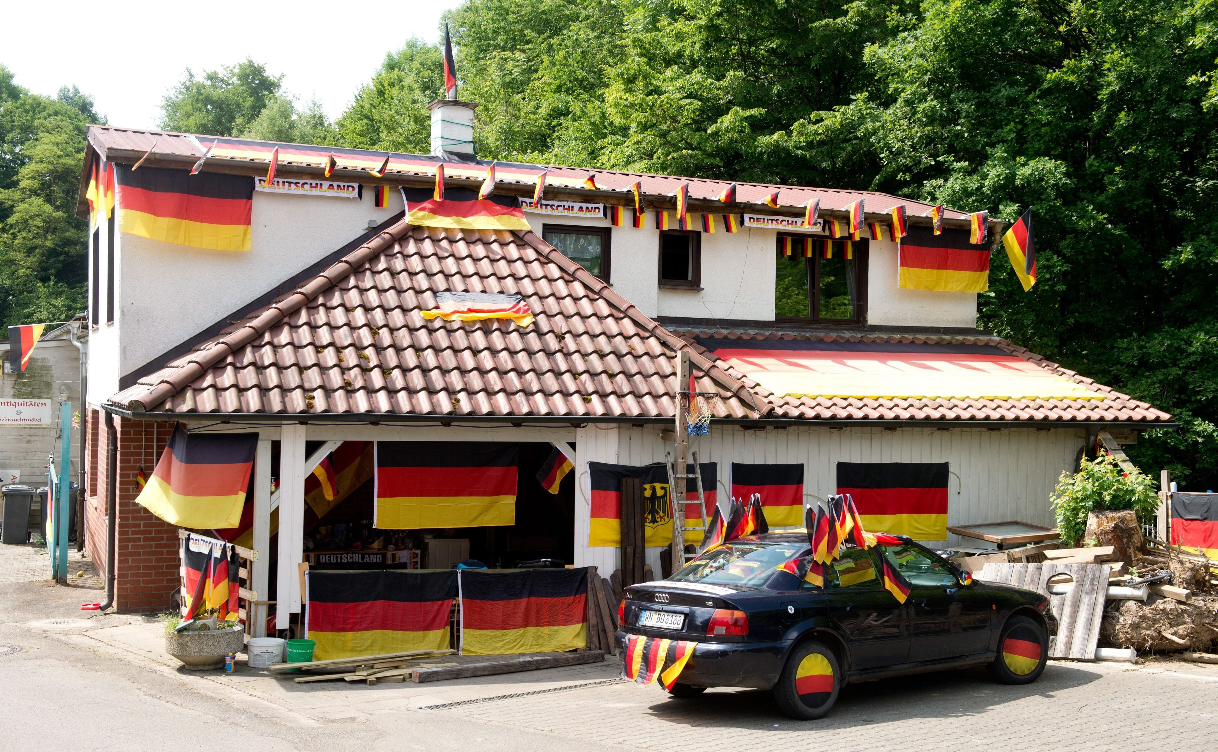 A house and a car in Maubach, Germany on June 12, 2014.