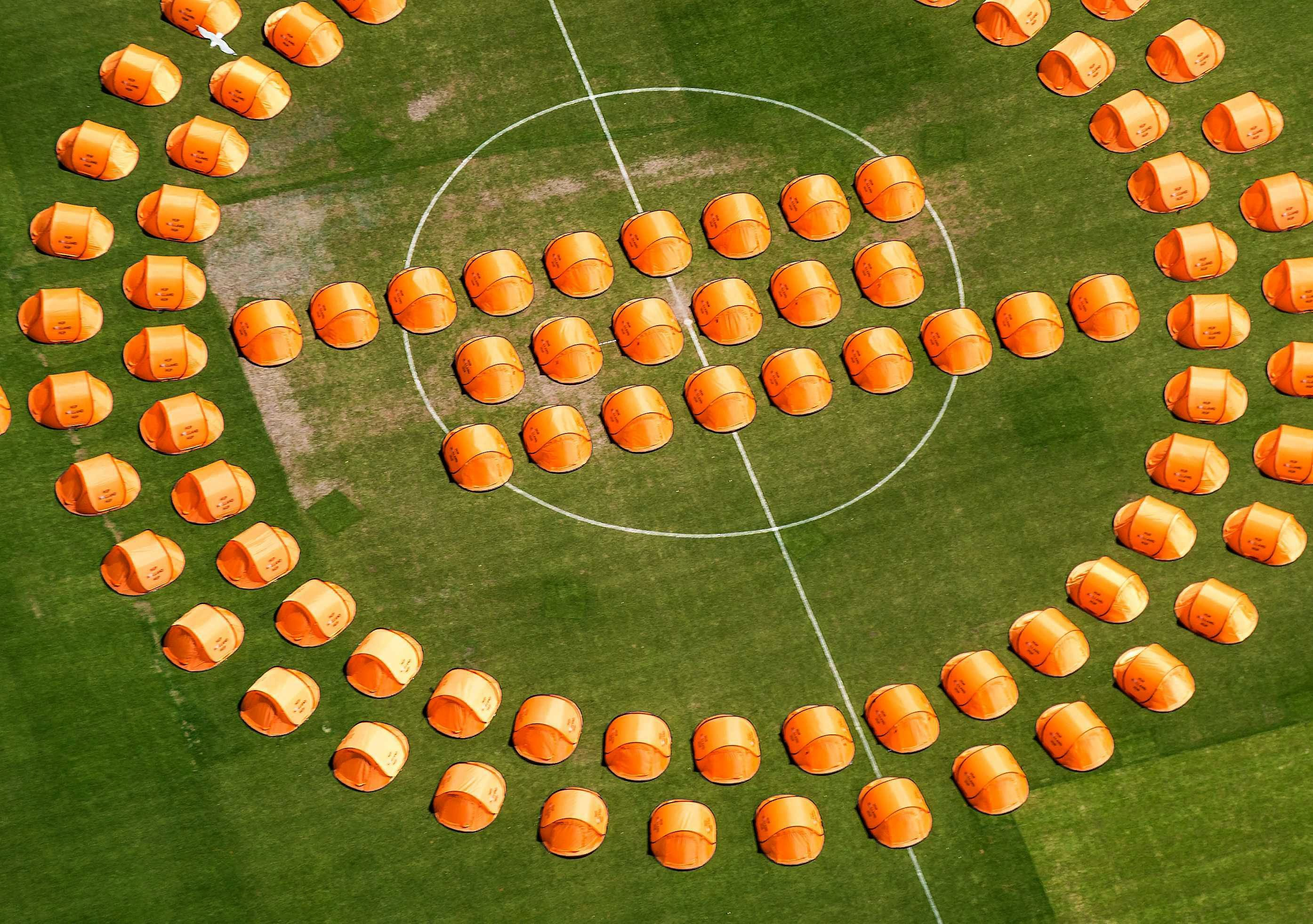 An aerial view of orange tents for Dutch soccer fans on the pitch at the Feyenoord Stadium in Rotterdam, Netherlands on June 13, 2014.