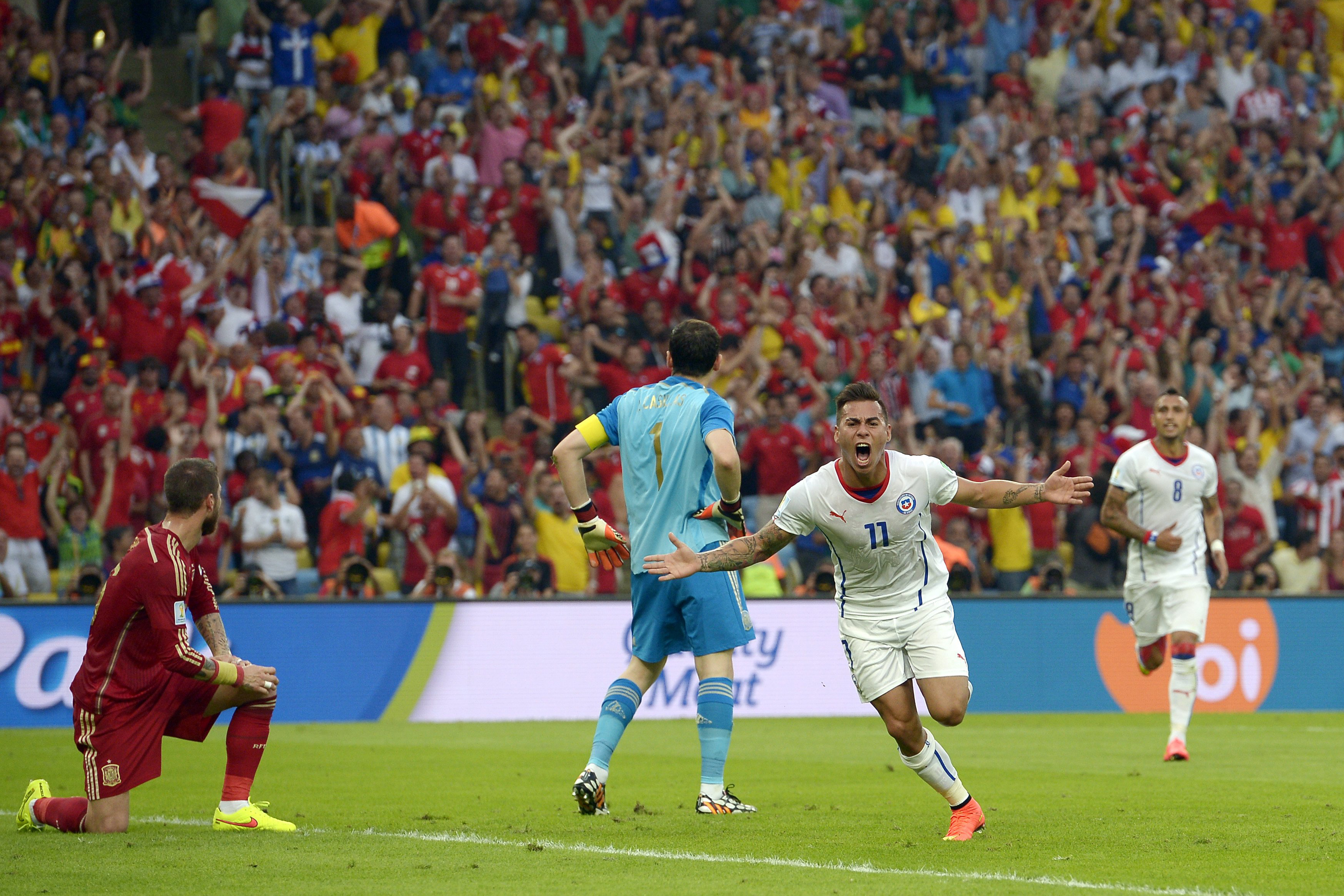 Chile's Eduardo Vargas celebrates after scoring the opening goal during the group B World Cup soccer match between Spain and Chile at the Maracana Stadium in Rio de Janeiro on June 18, 2014.