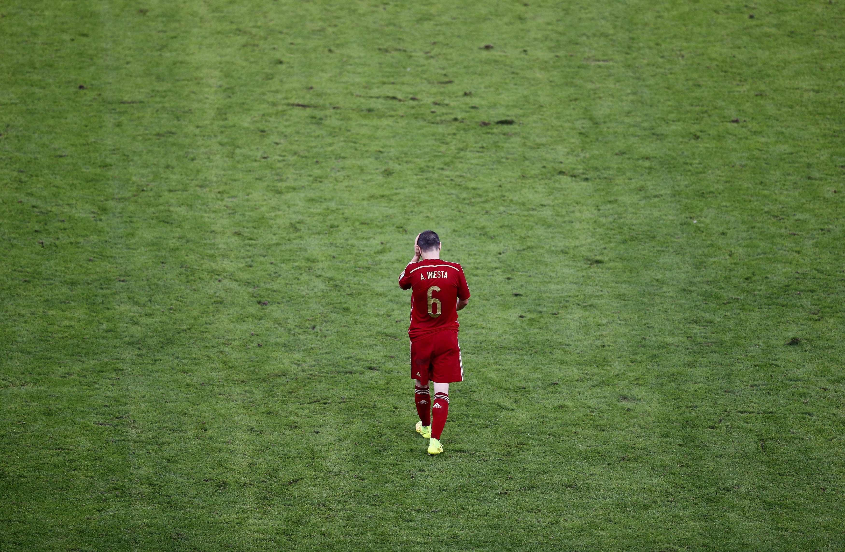 Spain's Andres Iniesta walks on the pitch during the 2014 World Cup Group B soccer match between Spain and Chile at the Maracana stadium in Rio de Janeiro on June 18, 2014.
