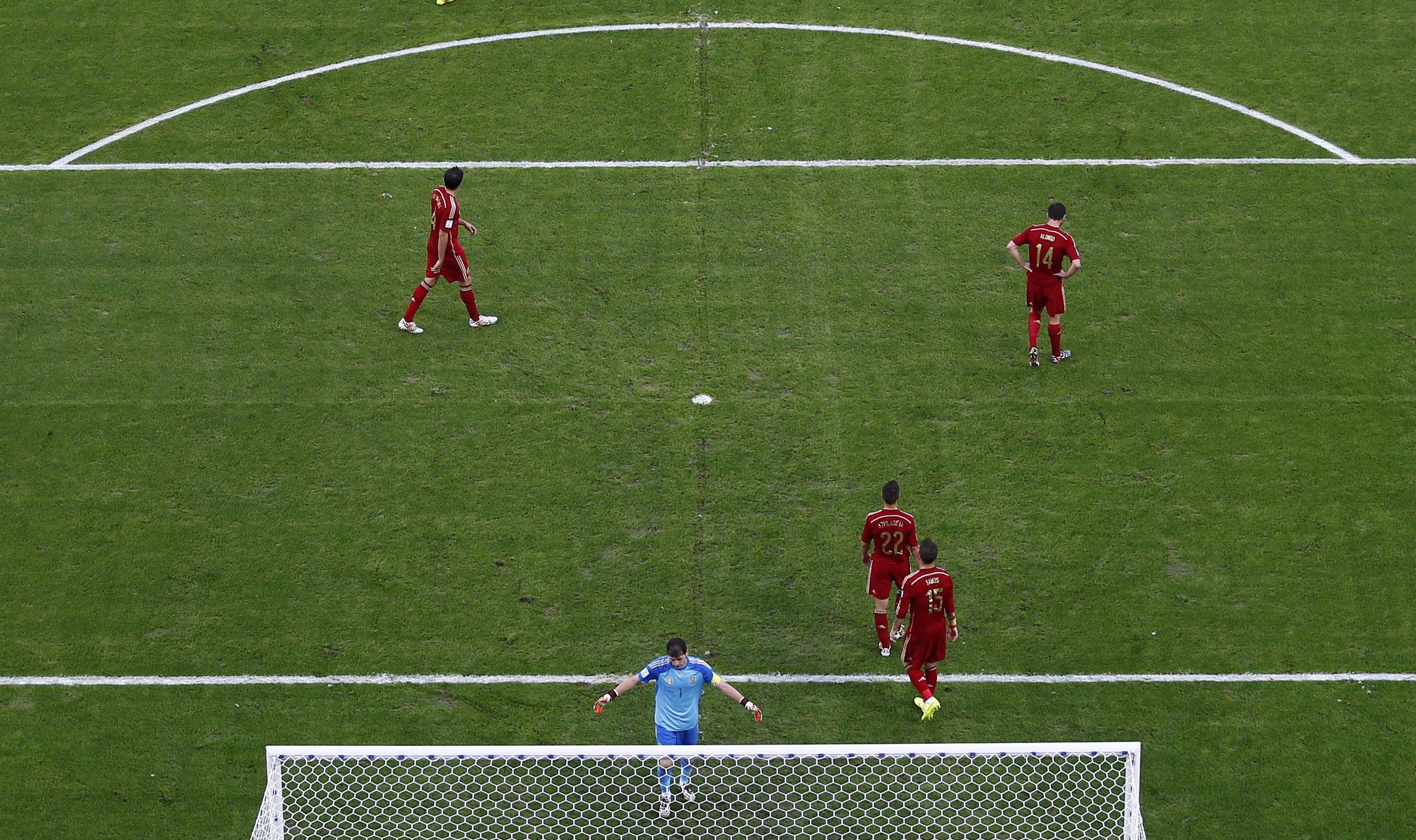 Spain players react after a goal by Chile's Eduardo Vargas during the 2014 World Cup Group B soccer match at the Maracana stadium in Rio de Janeiro on June 18, 2014.