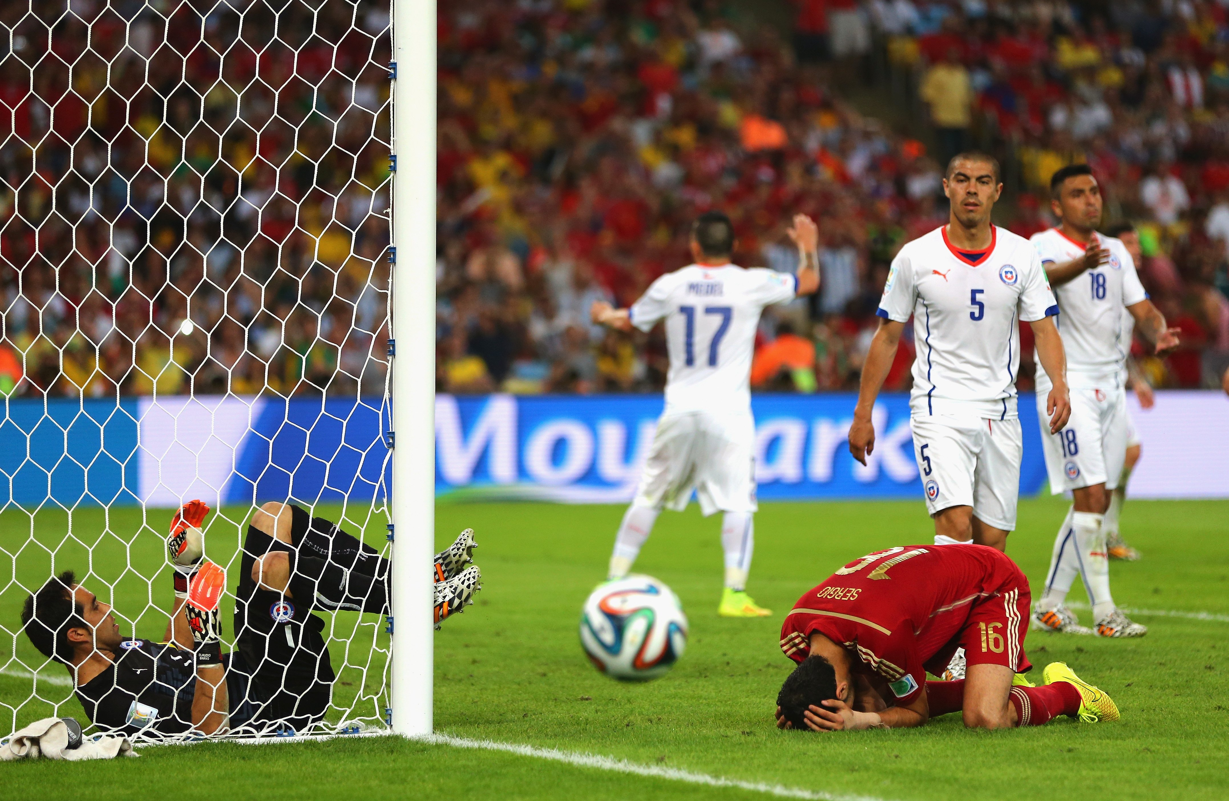 Sergio Busquets of Spain reacts after a missed chance as goalkeeper Claudio Bravo of Chile looks on during the 2014 FIFA World Cup Brazil Group B match between Spain and Chile at Maracana on June 18, 2014 in Rio de Janeiro.