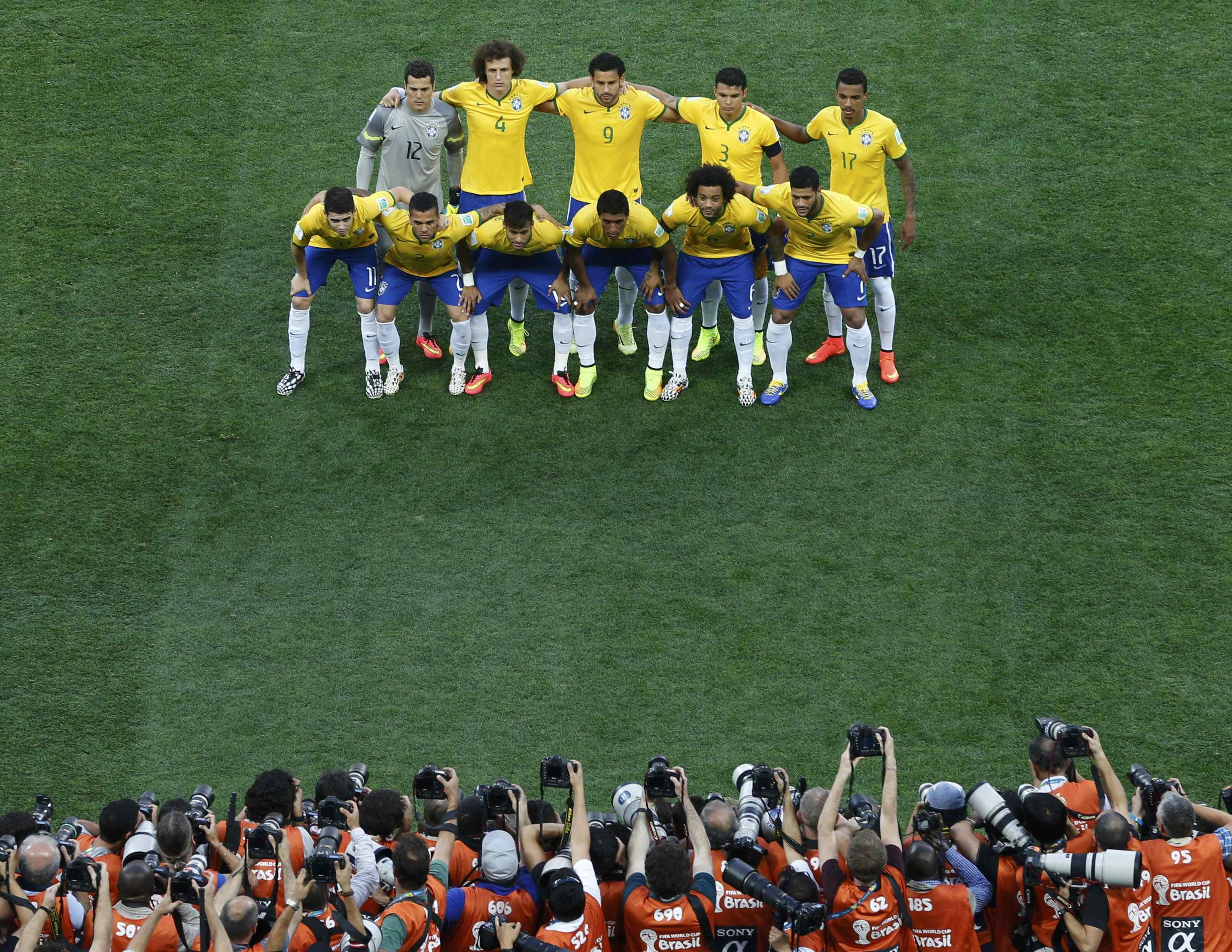 Brazil's national soccer players pose for a team photo before their 2014 World Cup opening match against Croatia at the Corinthians arena in Sao Paulo on June 12, 2014.