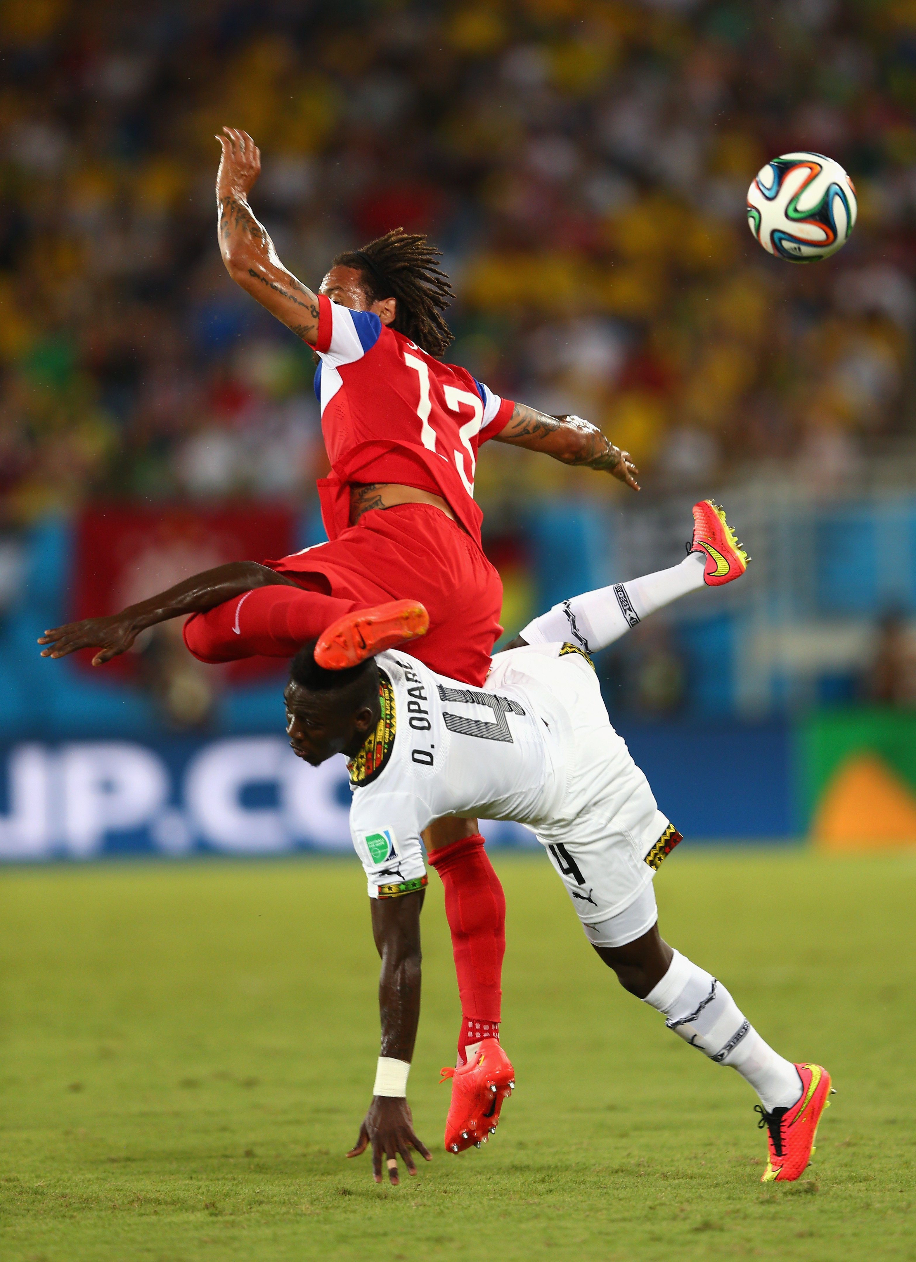 Daniel Opare of Ghana and Jermaine Jones of the United States collide during the 2014 FIFA World Cup Brazil Group G match between Ghana and the United States at Estadio das Dunas on June 16, 2014 in Natal, Brazil.