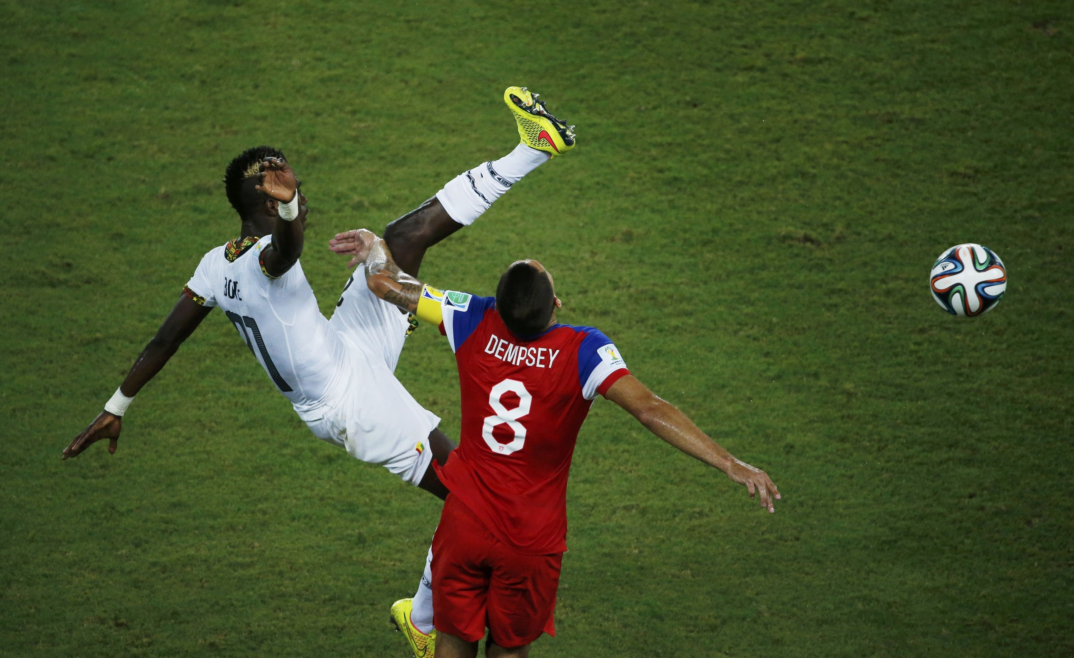 Ghana's John Boye (kicks high and knocks into the face of Clint Dempsey of the U.S. during their 2014 World Cup Group G soccer match at the Dunas arena in Natal, Brazil on June 16, 2014.
