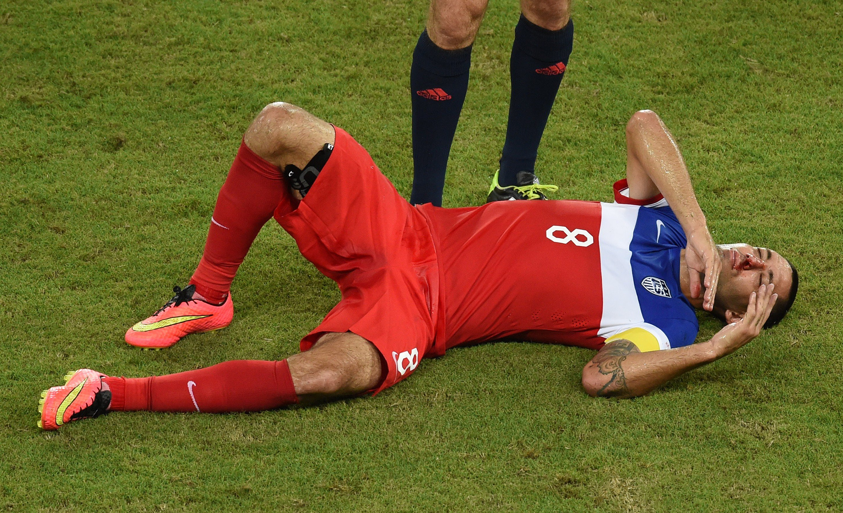 US forward Clint Dempsey bleeds from the nose after colliding with Ghana's defender John Boye during a Group G football match between Ghana and US at the Dunas Arena in Natal during the 2014 FIFA World Cup on June 16, 2014.