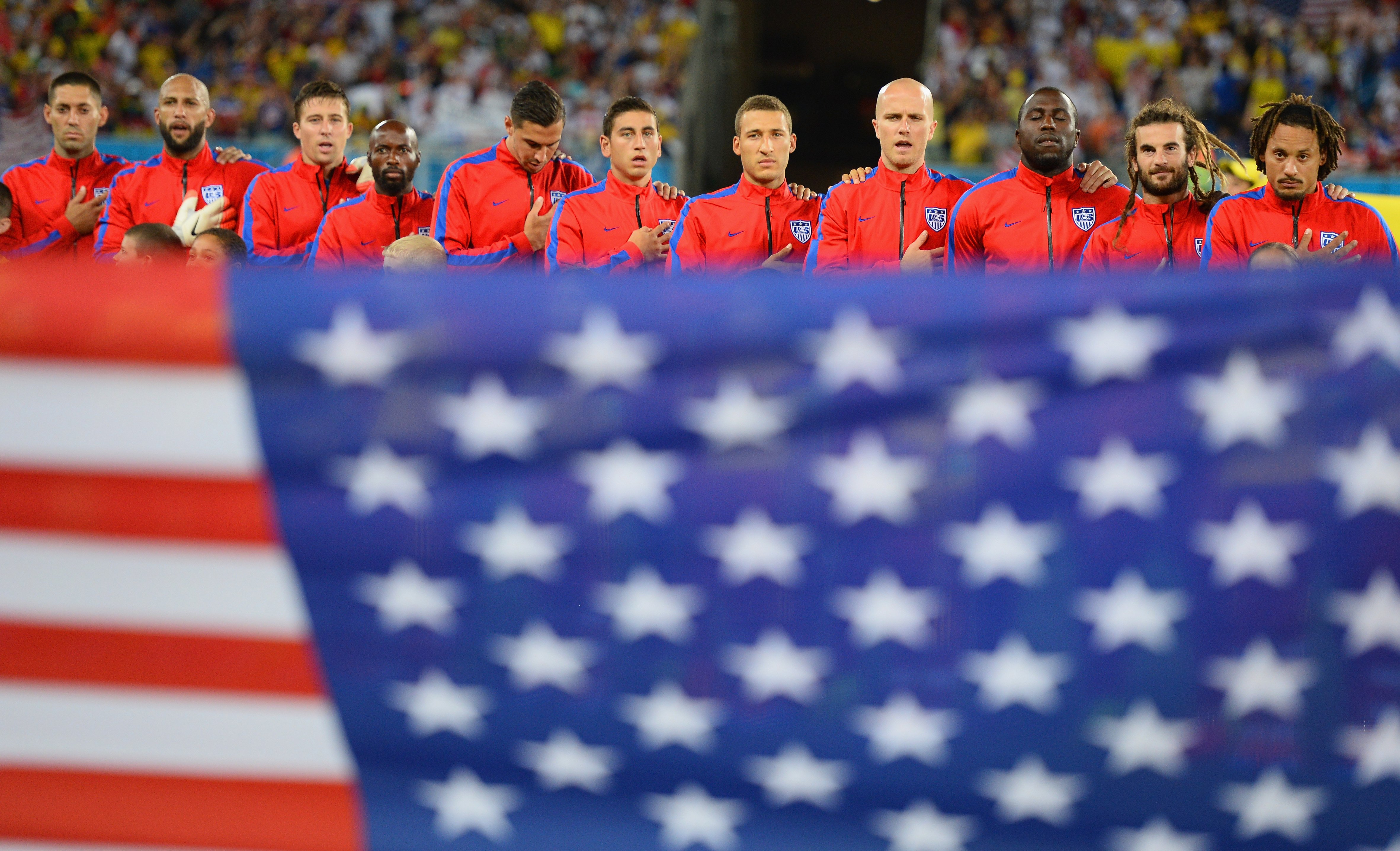 The United States players line up on the field before the 2014 FIFA World Cup Brazil Group G match between Ghana and the United States at Estadio das Dunas on June 16, 2014 in Natal, Brazil.