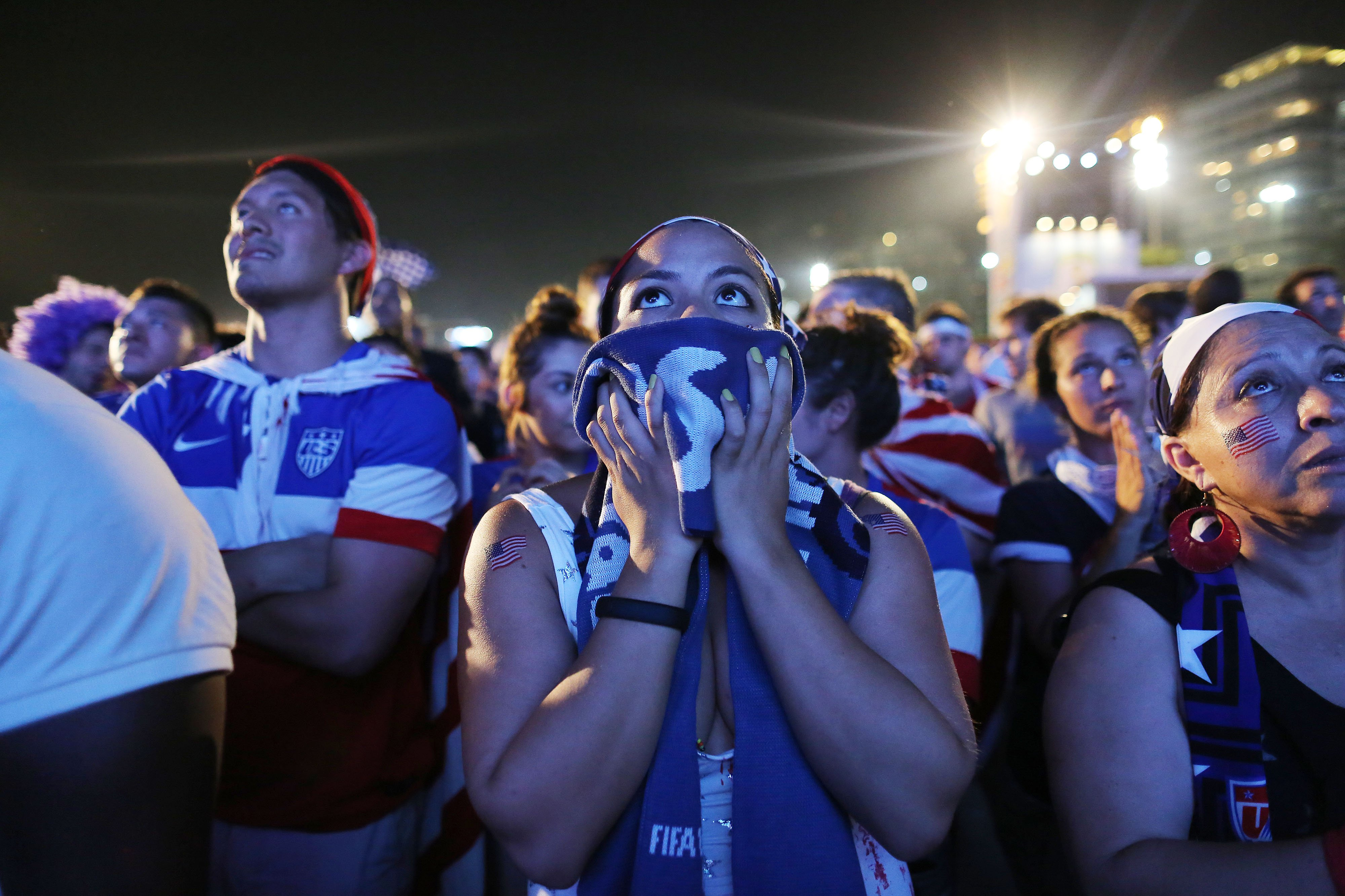 Soccer fans of the U.S. national soccer watch a live broadcast of the soccer World Cup match between USA and Ghana, inside the FIFA Fan Fest area on Copacabana beach, Rio de Janeiro, Brazil on June 16, 2014.