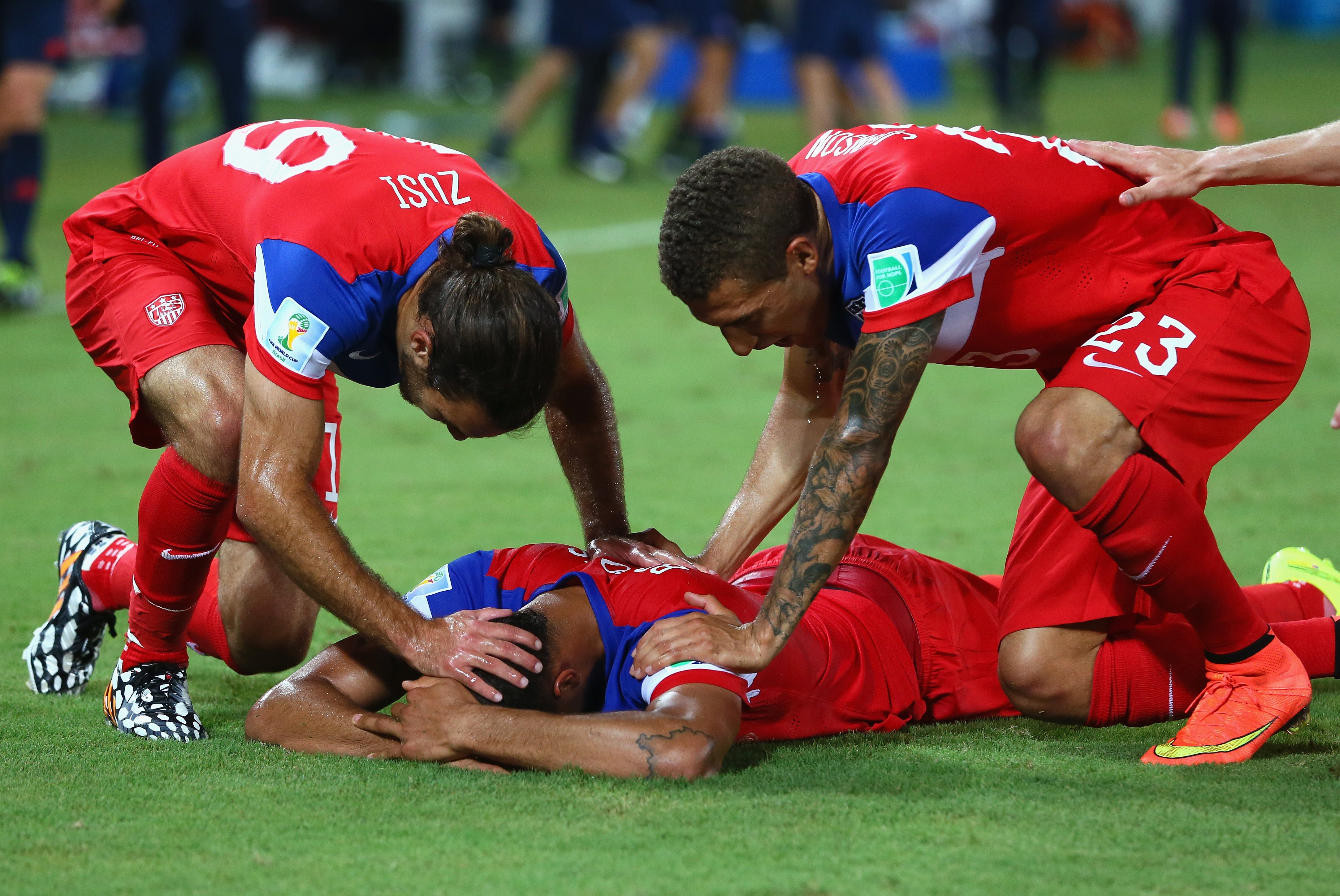 John Brooks of the United States celebrates scoring his team's second goal with Graham Zusi and Fabian Johnson during the 2014 FIFA World Cup Brazil Group G match between Ghana and the United States at Estadio das Dunas on June 16, 2014 in Natal, Brazil.