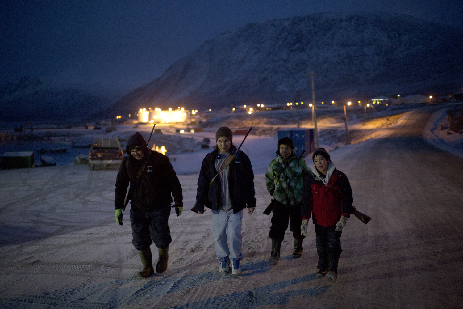 Pangnirtung, Canada,  Nov. 14, 2013. Upon returning from a hunting trip, Levi Ishlutak walks home with his sons (left to right) Dimitri, 17, Paul, 12, and Damien, 10.
