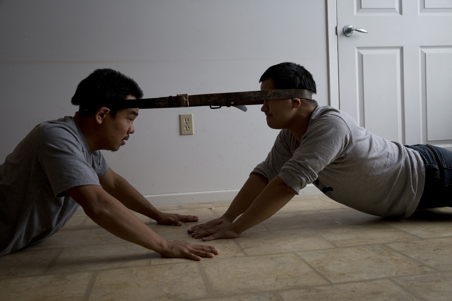 Arviat, Canada, Oct. 16, 2013. William Tiktaq (left), 28, and Brian Tagalik (right), 28, compete with each other in an Inuit head pull competition. Inuit games are played as a way to pass the time during the cold arctic winters and to test and develop the skills required for hunting and arctic survival.