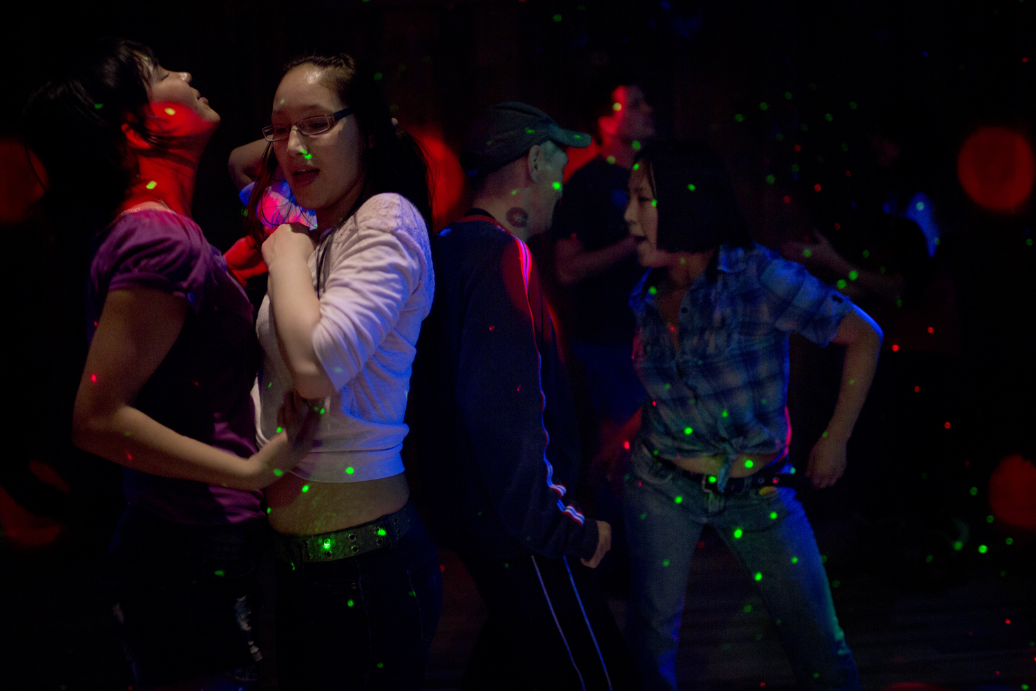Canada, Sept. 17, 2013. Kelly Amaujaq Fraser (left) dances with friends at a bar.