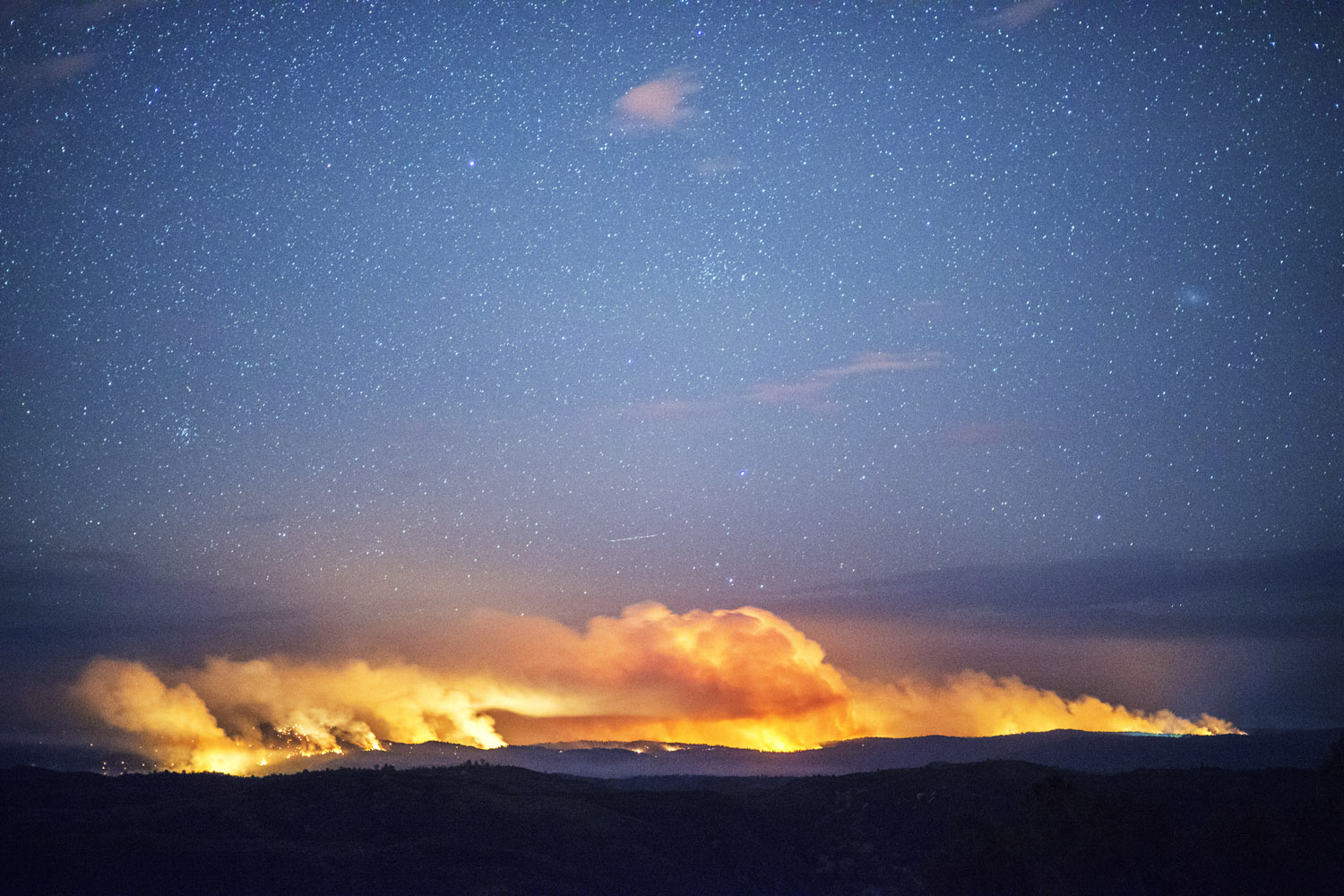 The Rim Fire burns through Yosemite National park and the Stanislaus National Forest in late August. Multiple heads to the fire can be seen in this long exposure image.