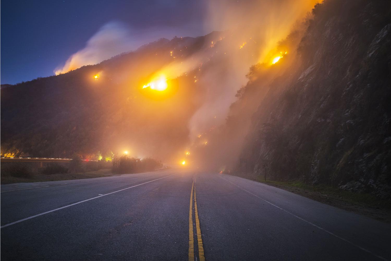 The Colbert Fire burns off Highway 39 near Azusa, Calif., Jan. 17 , 2014.