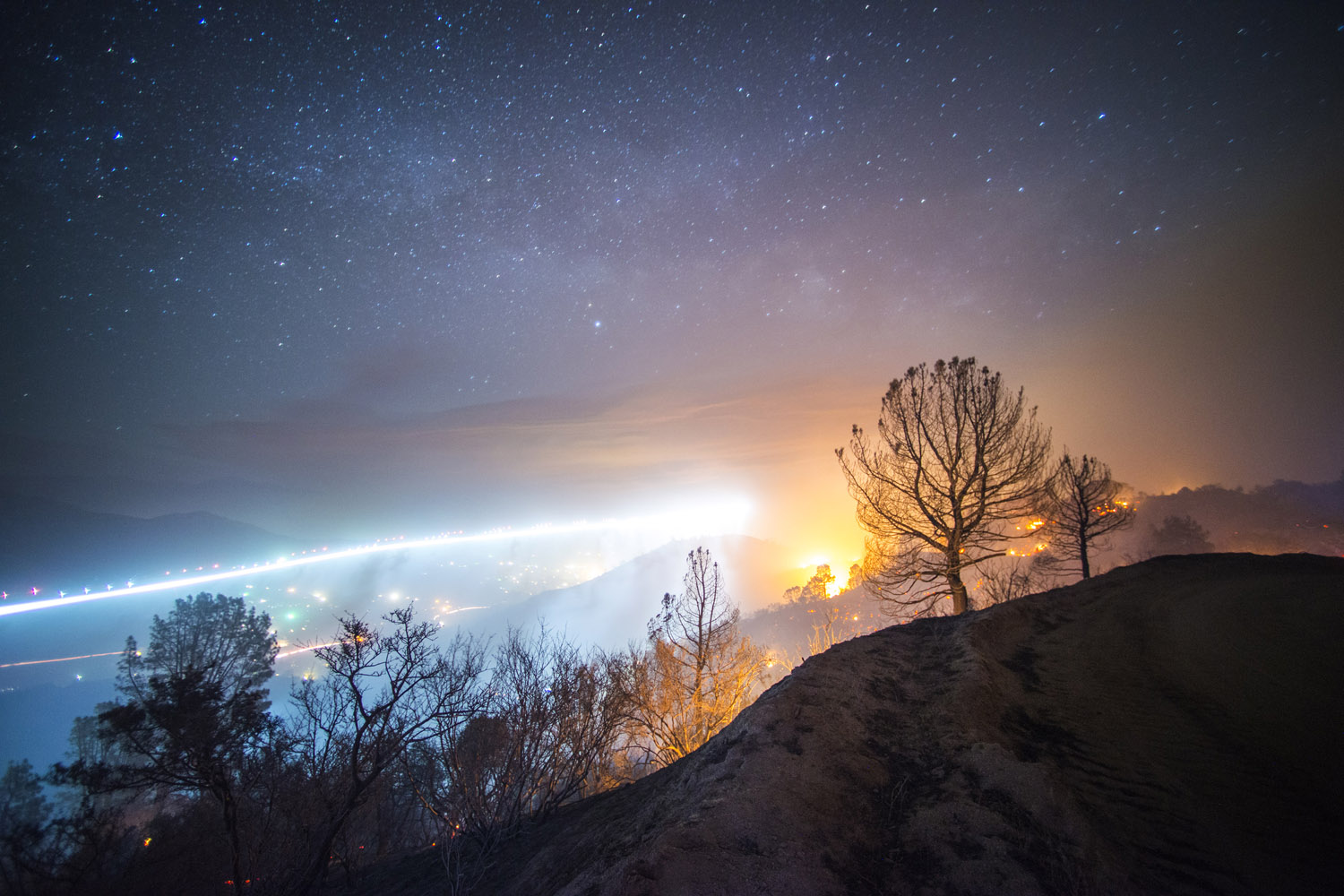 The Shirley Fire burns at night off of Old State Rd near Lake Isabella, Calif.,  while a helicopter flies overhead. June 15, 2014.