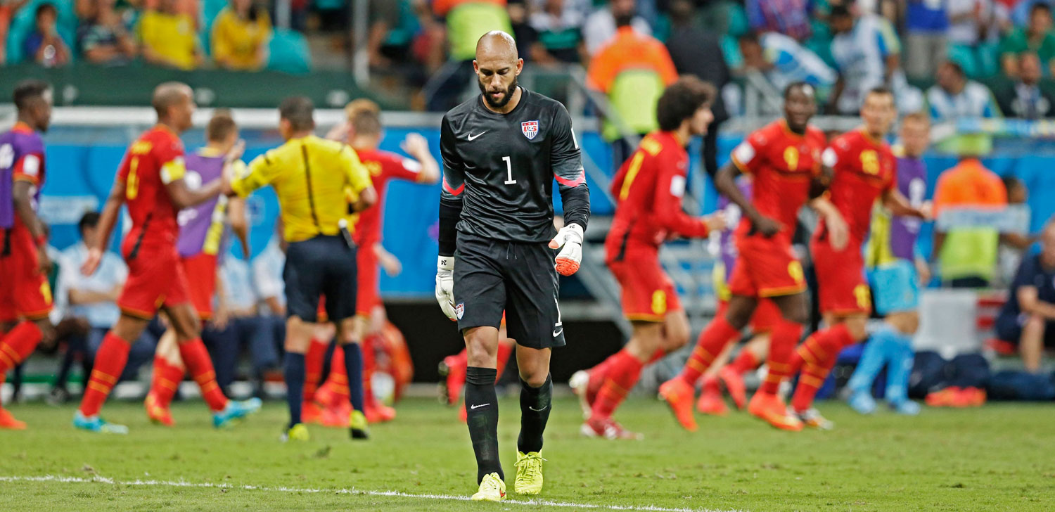 Belgium vs. United States 2-1                                                              USA's goalkeeper Tim Howard reacts as Belgium's players celebrate their goal at the Arena Fonte Nova in Salvador, Brazil on July 1, 2014.