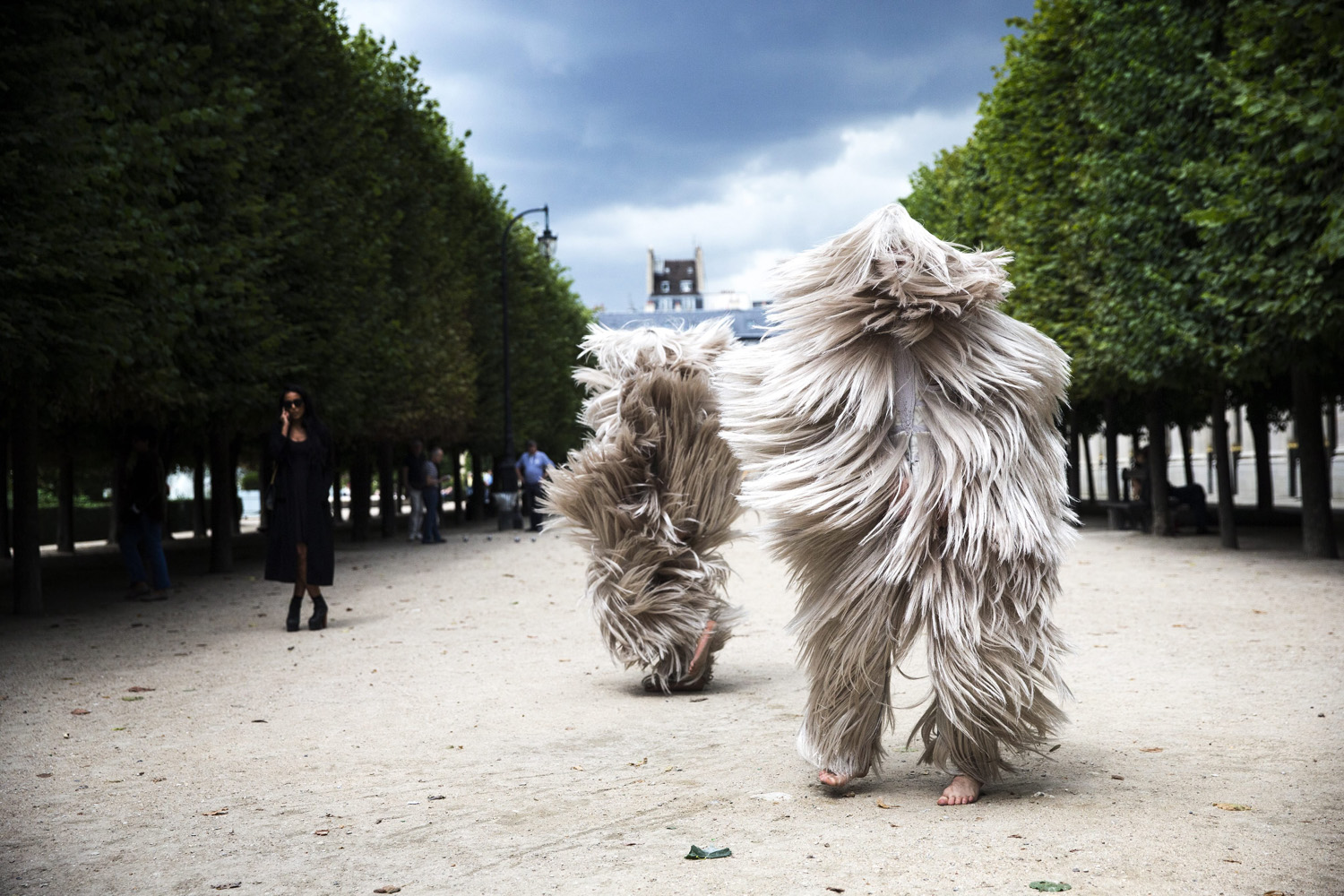 Performers present creations from the Haute Coiffure Fall-Winter 2014/15 collection by French designer Charlie Le Mindu during the Paris Fashion Week, in Paris on July 7, 2014.